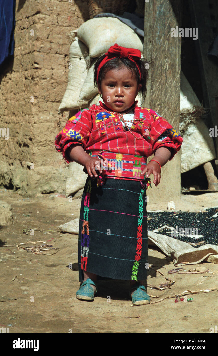 Young girl wearing the dress specific to her community Santiago Chimaltenango Dept of Huehuetenango Guatemala Central America - Stock Image