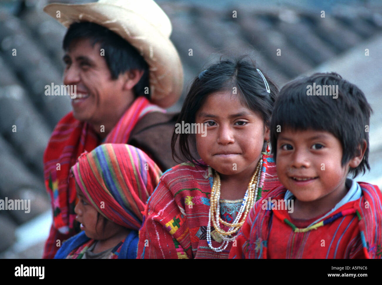 Maya family father and children from San Juan Atitan Dept of Huehuetenango Guatemala Central America Tribal attire Identity - Stock Image