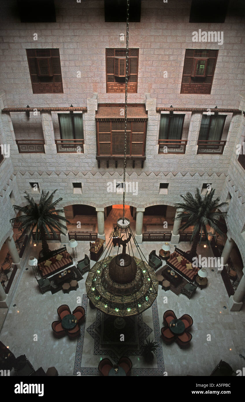 The Movenpick located right by the entrance to the ancient site of Petra The central atrium and luxurious surroundings Jordan - Stock Image