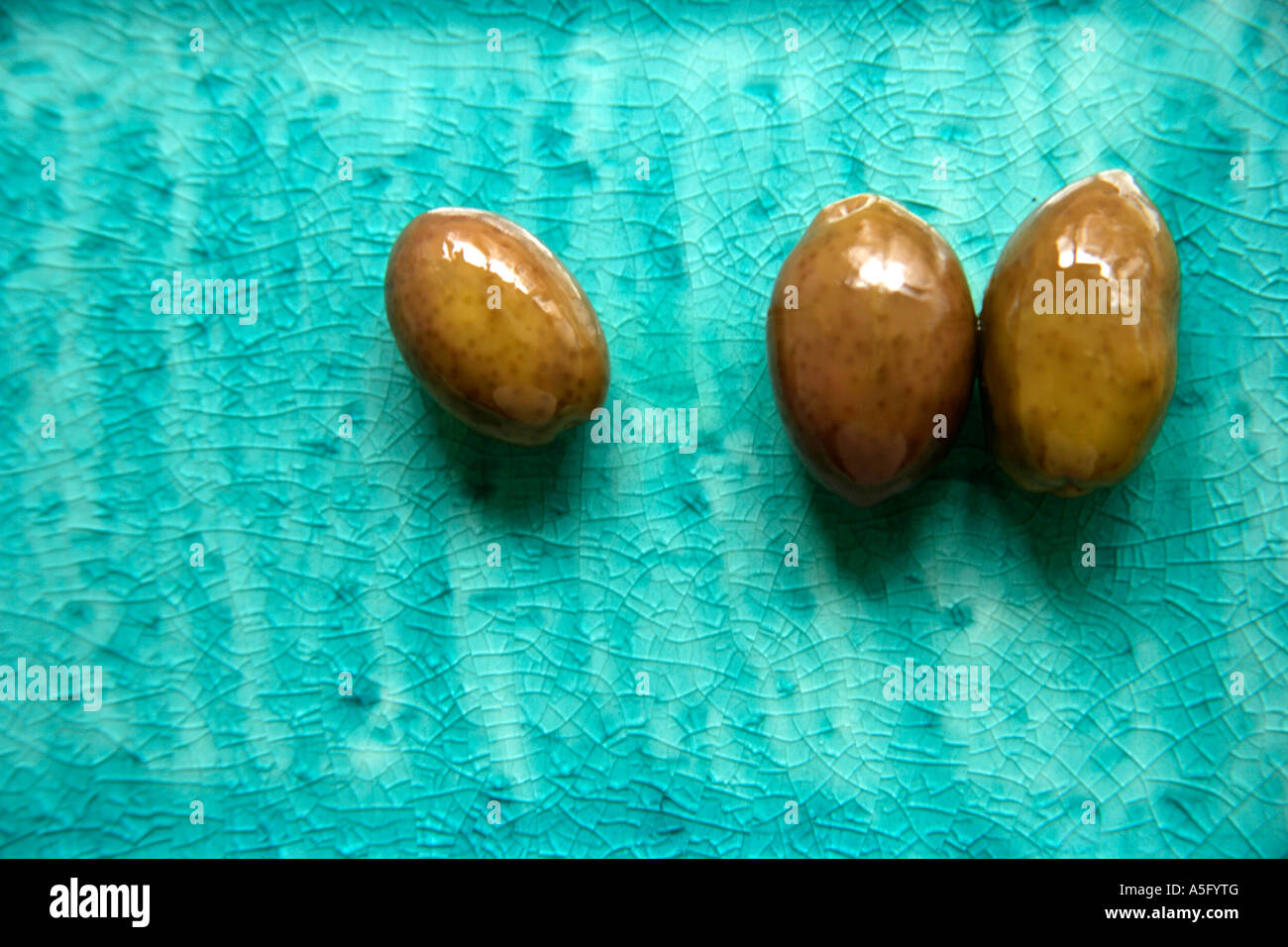 OLIVES ON PLATE - Stock Image