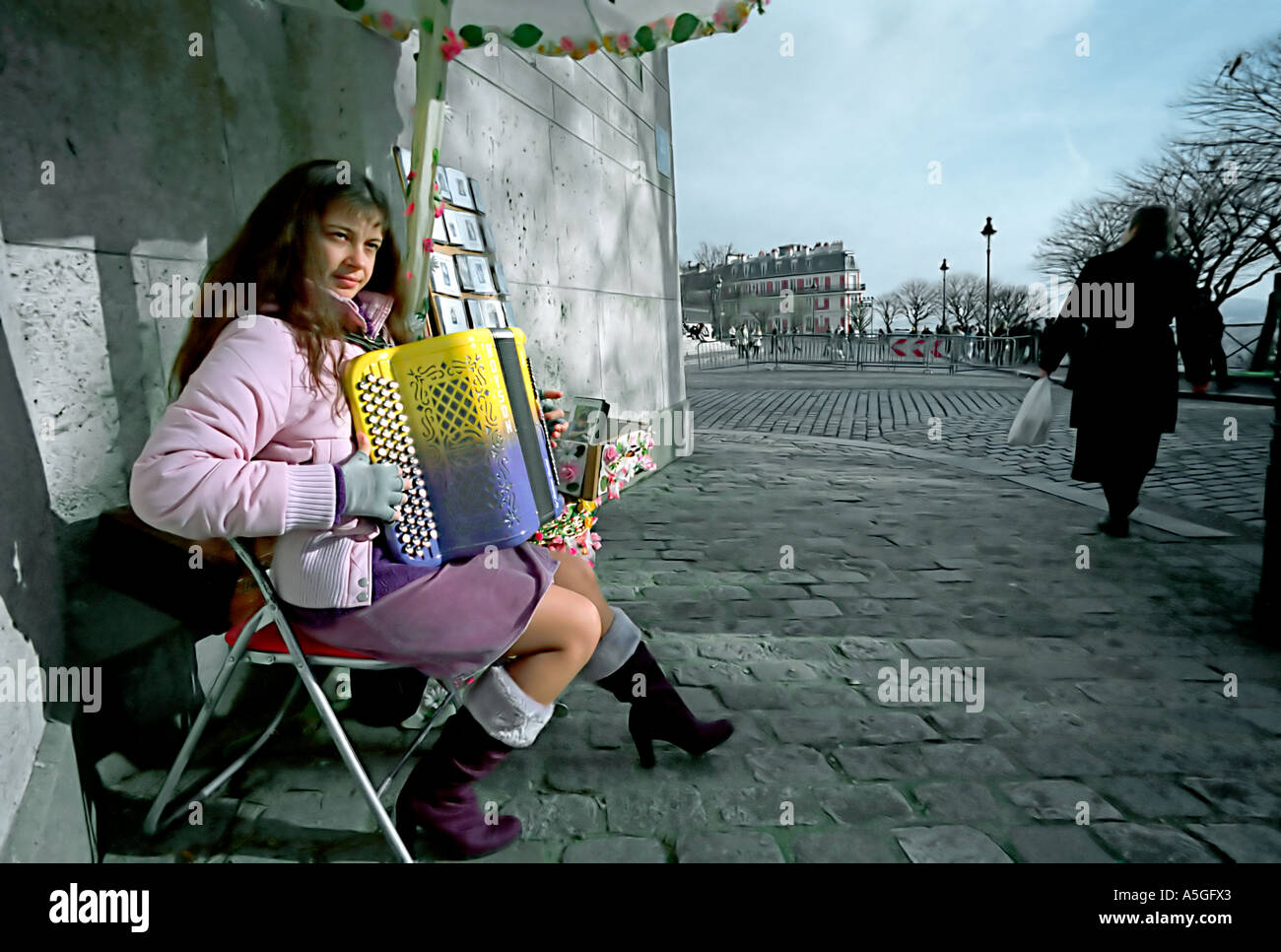 Severine a well known accordion player in Montmartre performs for tourists and visitors to the nearby Sacre Coeur Stock Photo