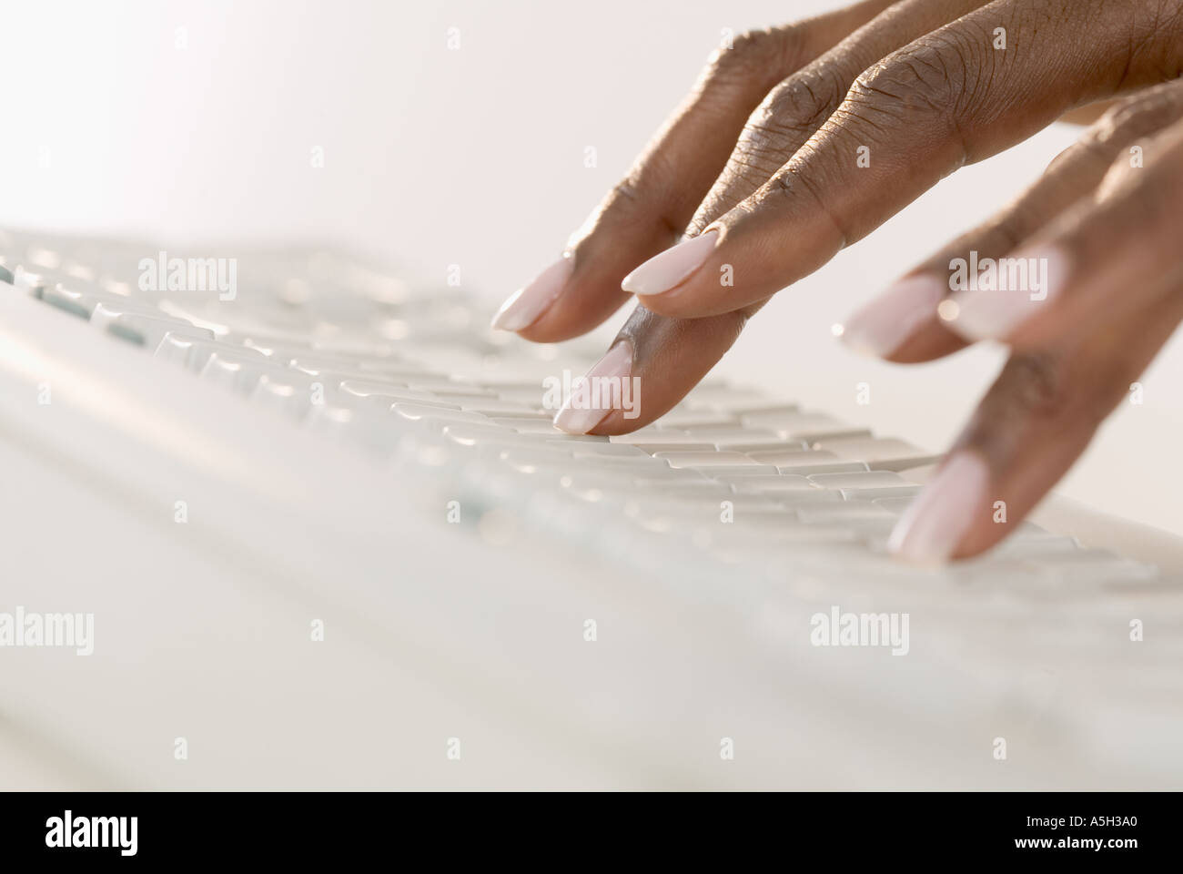 Female hands on a computer keyboard - Stock Image