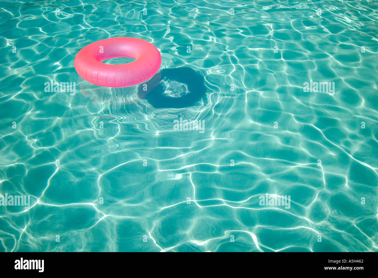 Floatation device in a swimming pool Stock Photo