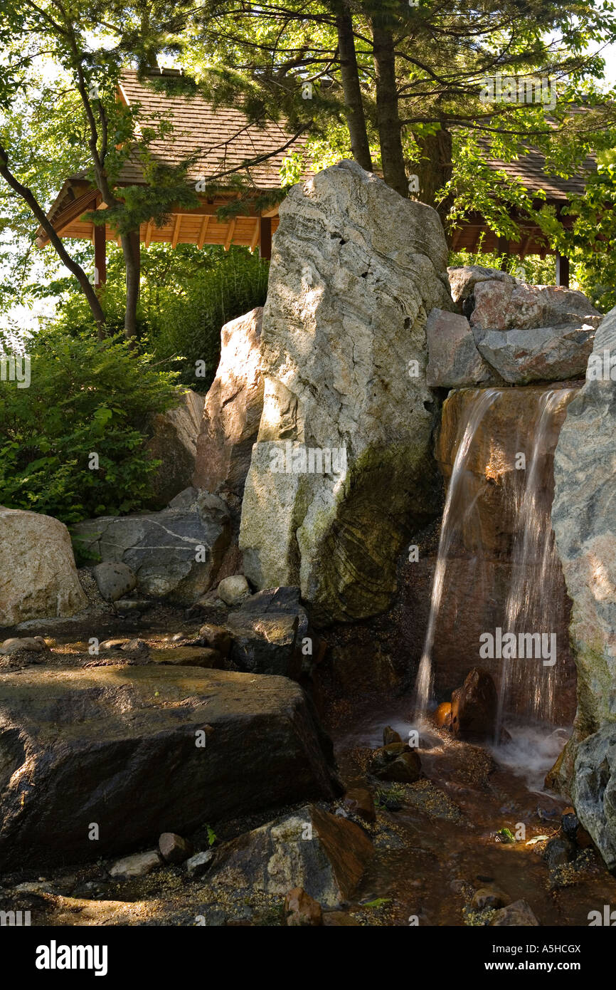 ILLINOIS Chicago Waterfall over stones in Osaka Japanese Garden in ...