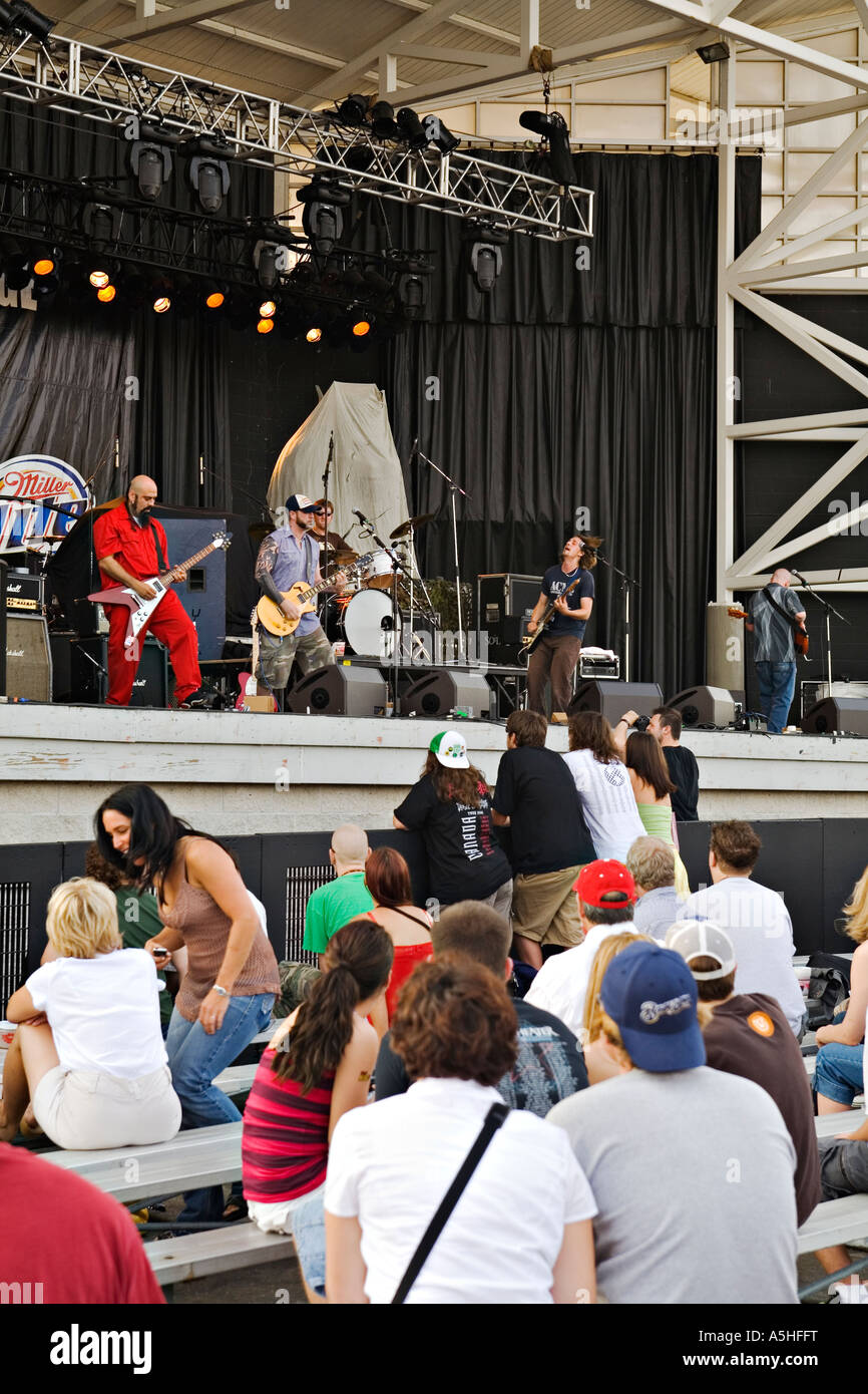 WISCONSIN Milwaukee Rock band perform on stage at Summerfest musical festival fans seated in front of group - Stock Image