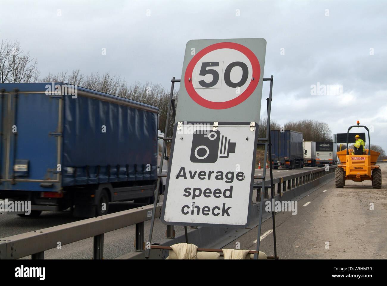 Average Speed camera warning sign, in roadworks, M1 Motorway, South Yorkshire, UK - Stock Image