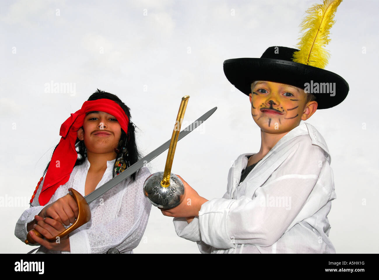 Two 9 year old school pupils at School in Hounslow dressed as characters from Pirates of the Caribbean film, Middlesex, - Stock Image