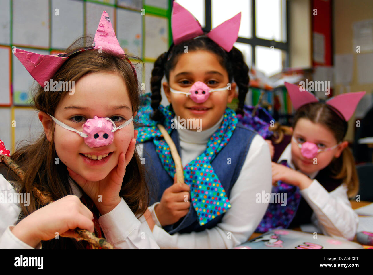 Infant school pupils dressed as characters from The Three Little Pigs as part of National Book Week, Surbiton, UK. - Stock Image