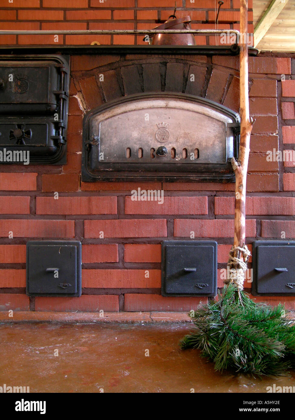 PR Old Wood Heated Kitchen Stove With Baking Oven Made Of Stone A Broom Branches Pines
