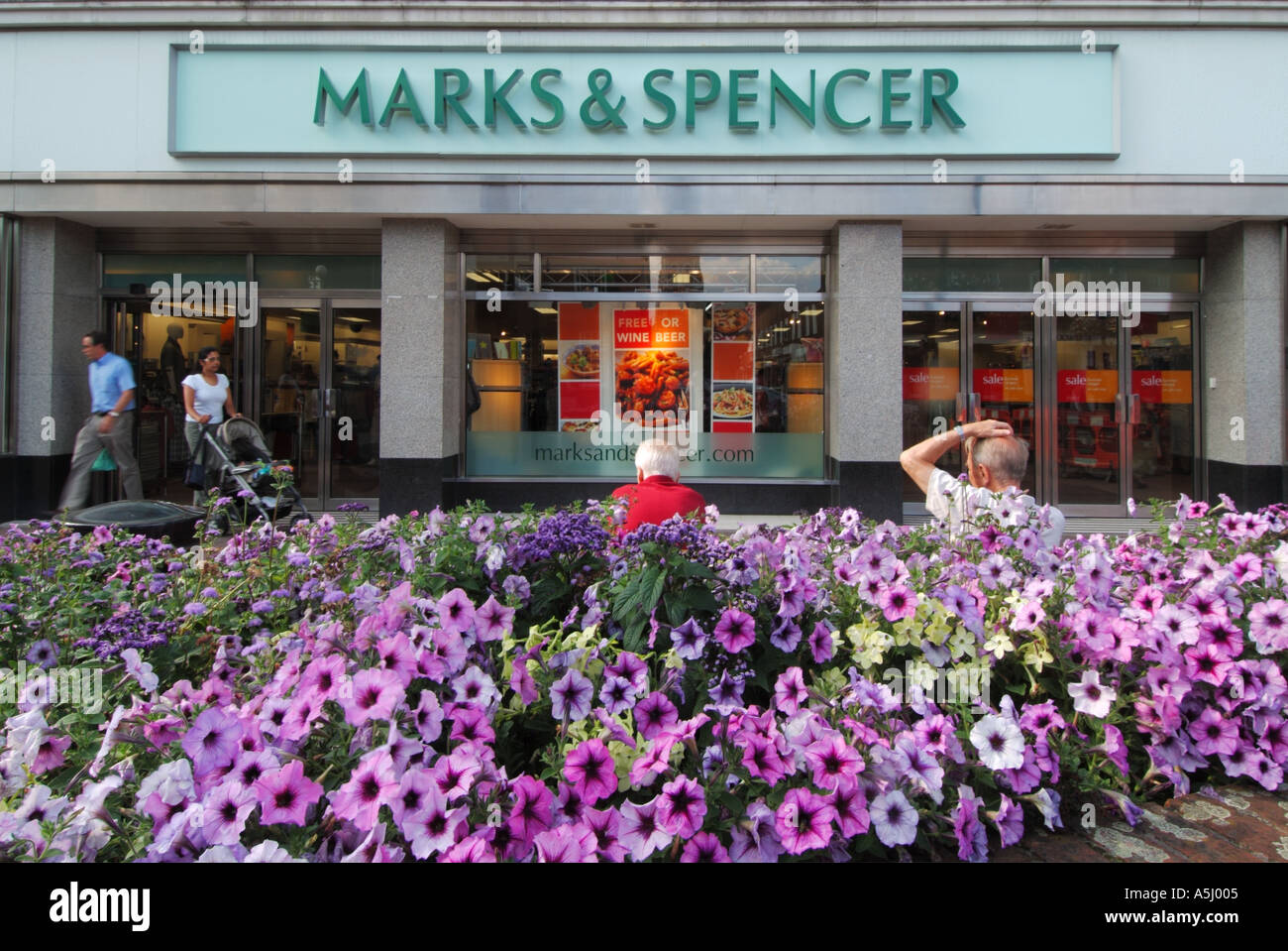 Flower shop window display plants stock photos flower shop window brentwood town centre marks and spencer store in high street with summer bedding floral displays and izmirmasajfo
