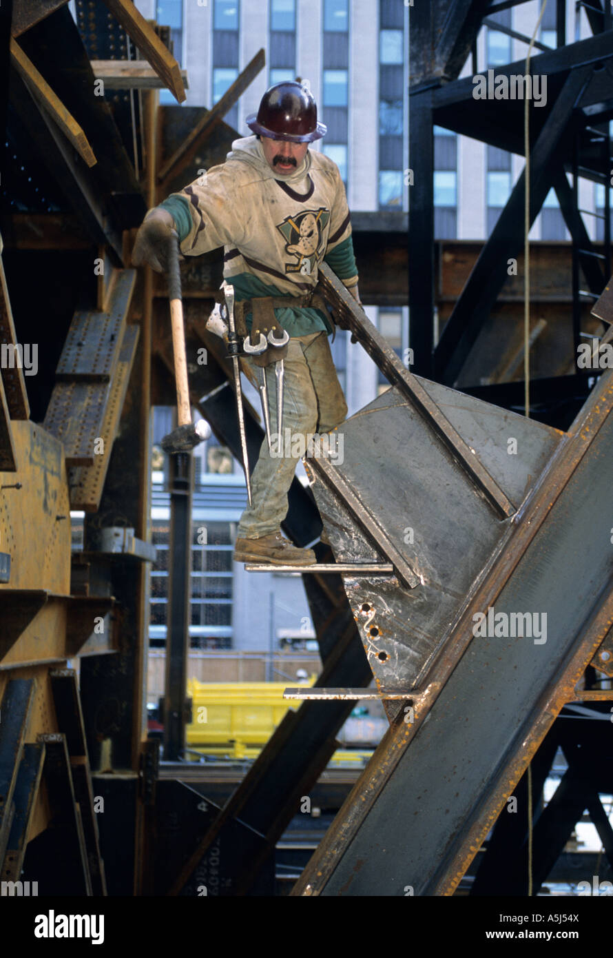 Mohawk indian iron worker catches a sledge hammer to persuade some