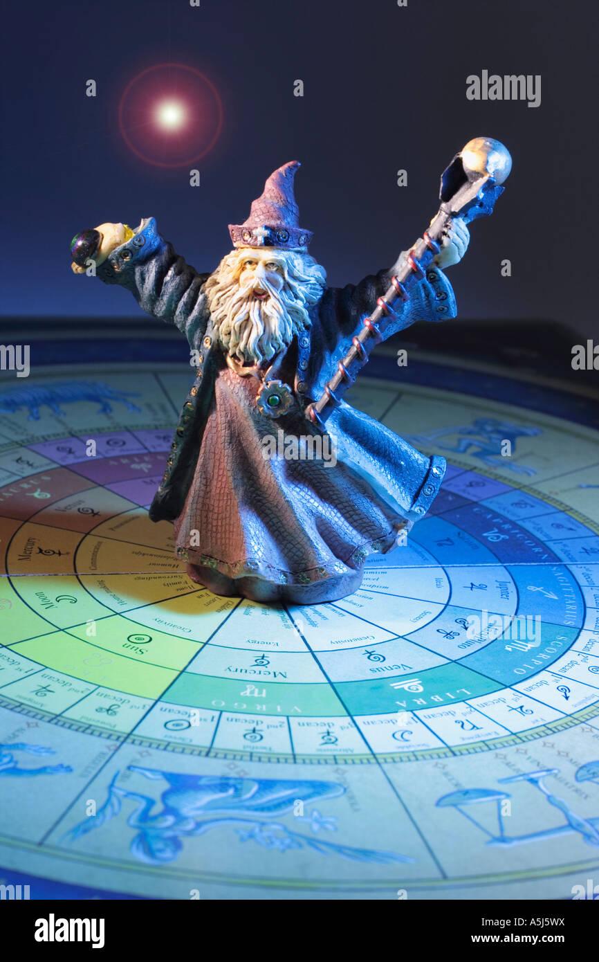 Wizard Figurine on Tarot Board - Stock Image
