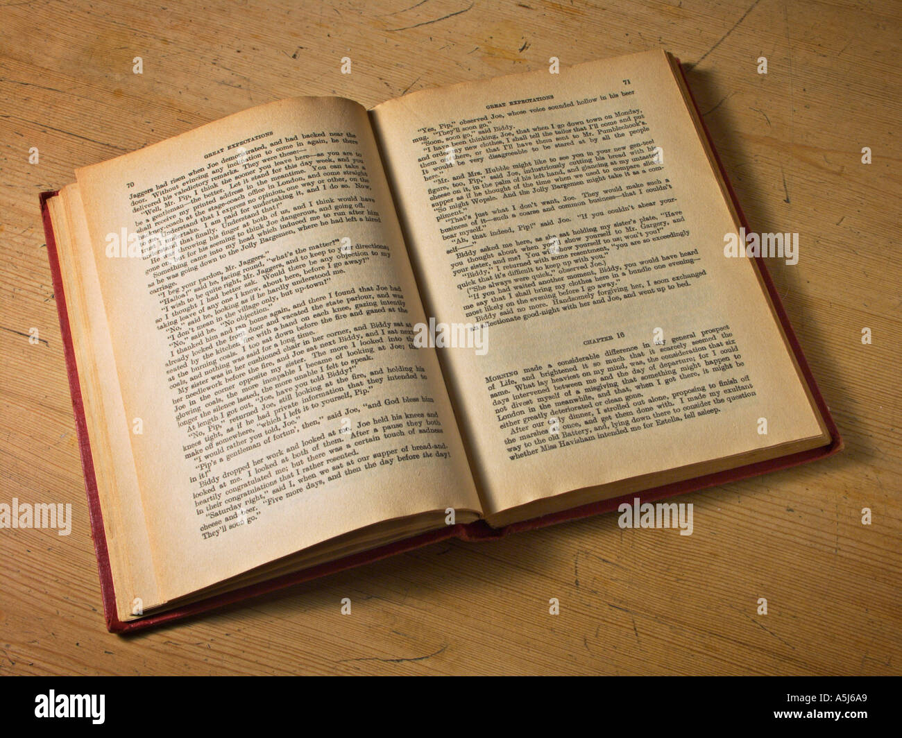 an old book open on a table stock photo 2090664 alamy
