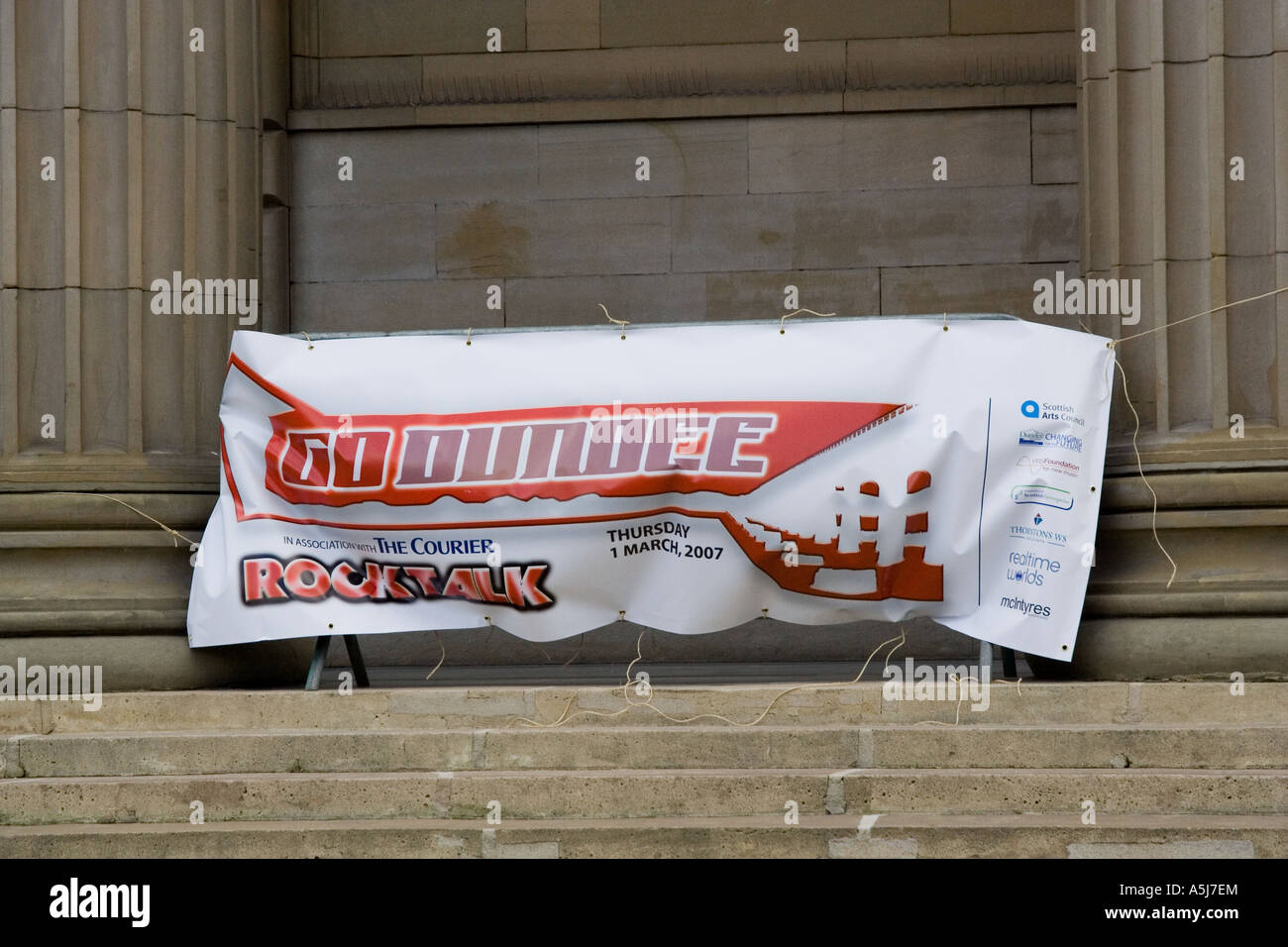 A Banner between two columns advertising a Rock Talk festival in front of the Caird Hall in the City of Dundee, - Stock Image