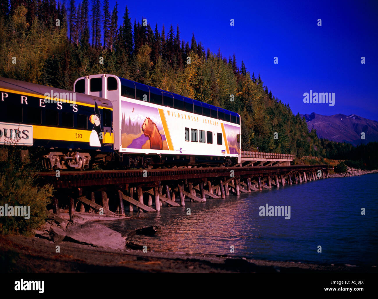 The Alaska Railroad and RCCL Wilderness Express, crossing the Lower Trail Lake trestle on its way to Seward - Stock Image