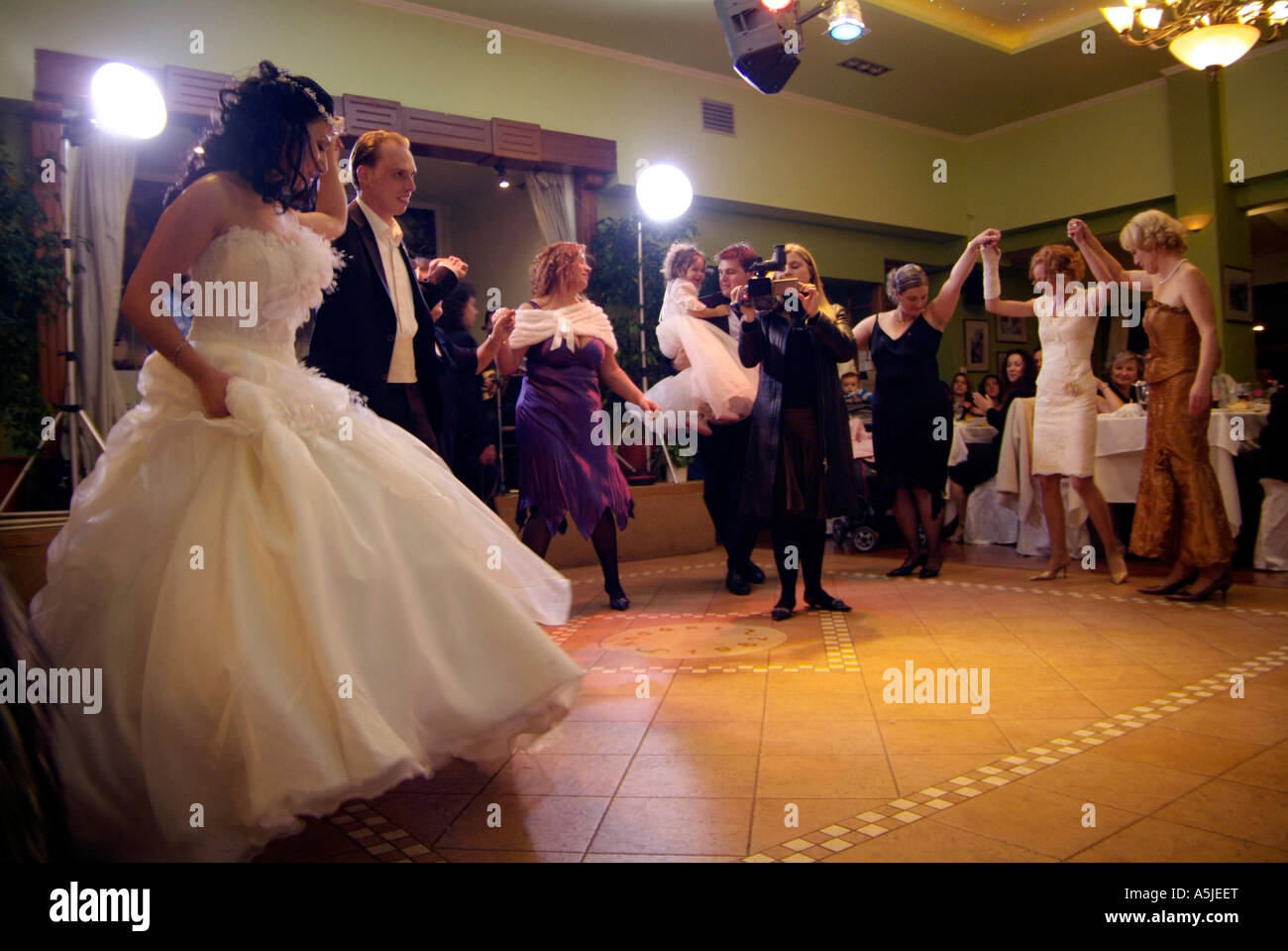 Bride And Groom Dancing At Their Wedding Reception Party Stock