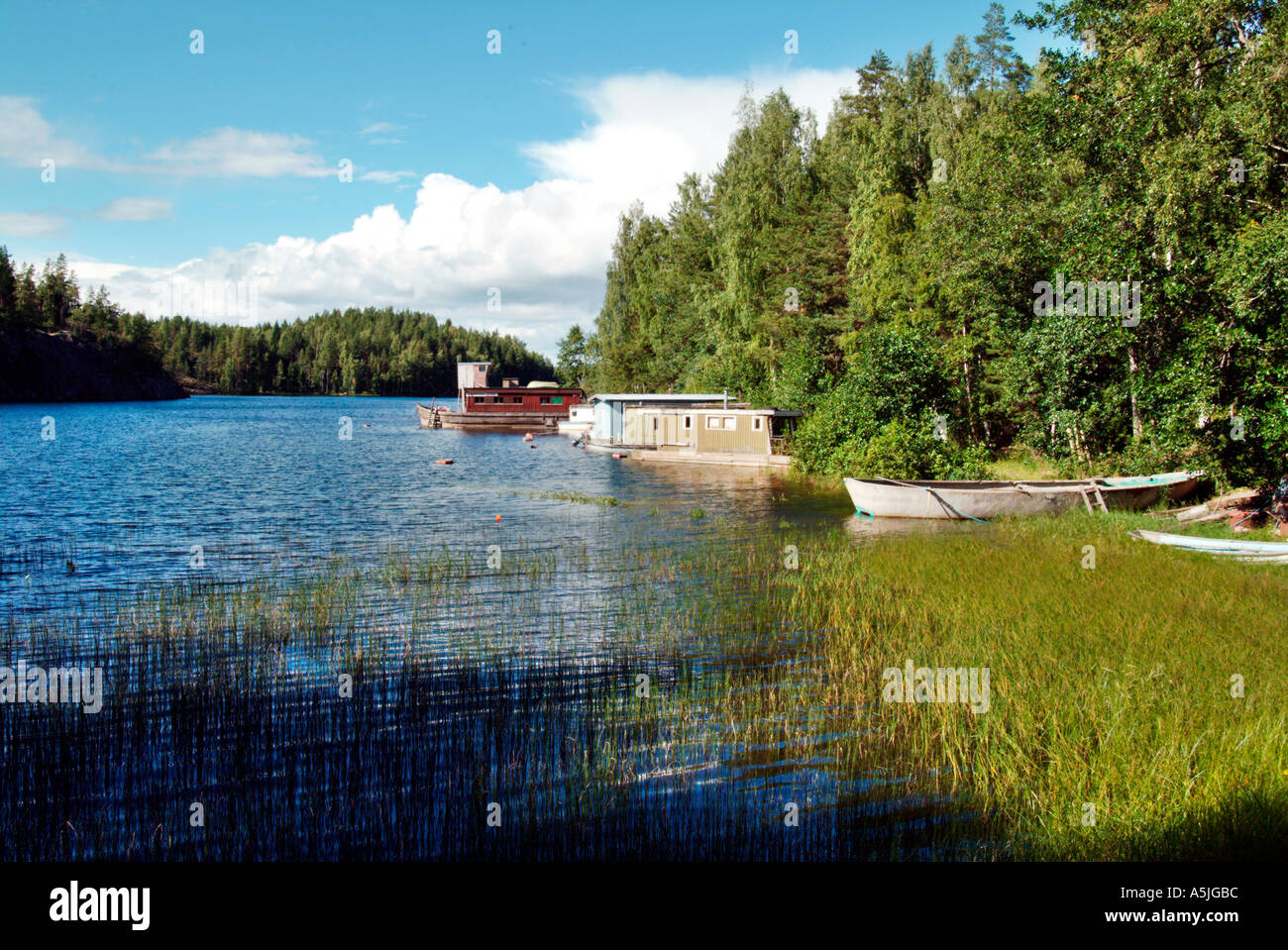 lake distrikt middle Finland lake Saimaa boats on the lakefront old house boats Stock Photo