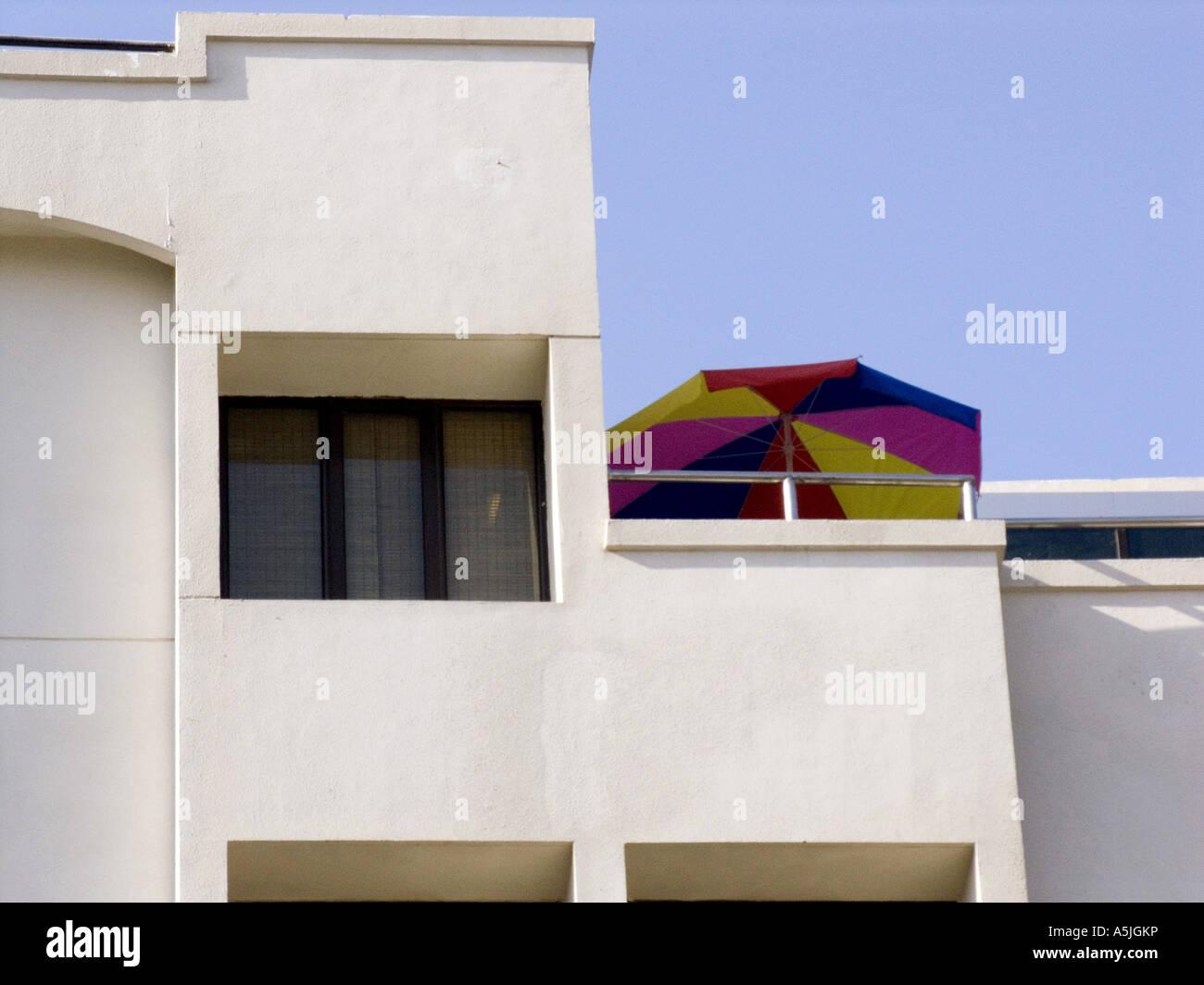 MGM102839 Umbrella on roof of modern building Hyderabad