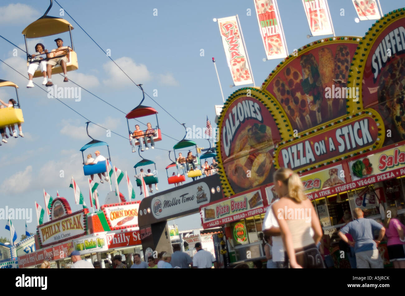 People and rides at the Illinois State Fair in Springfield Illinois - Stock Image
