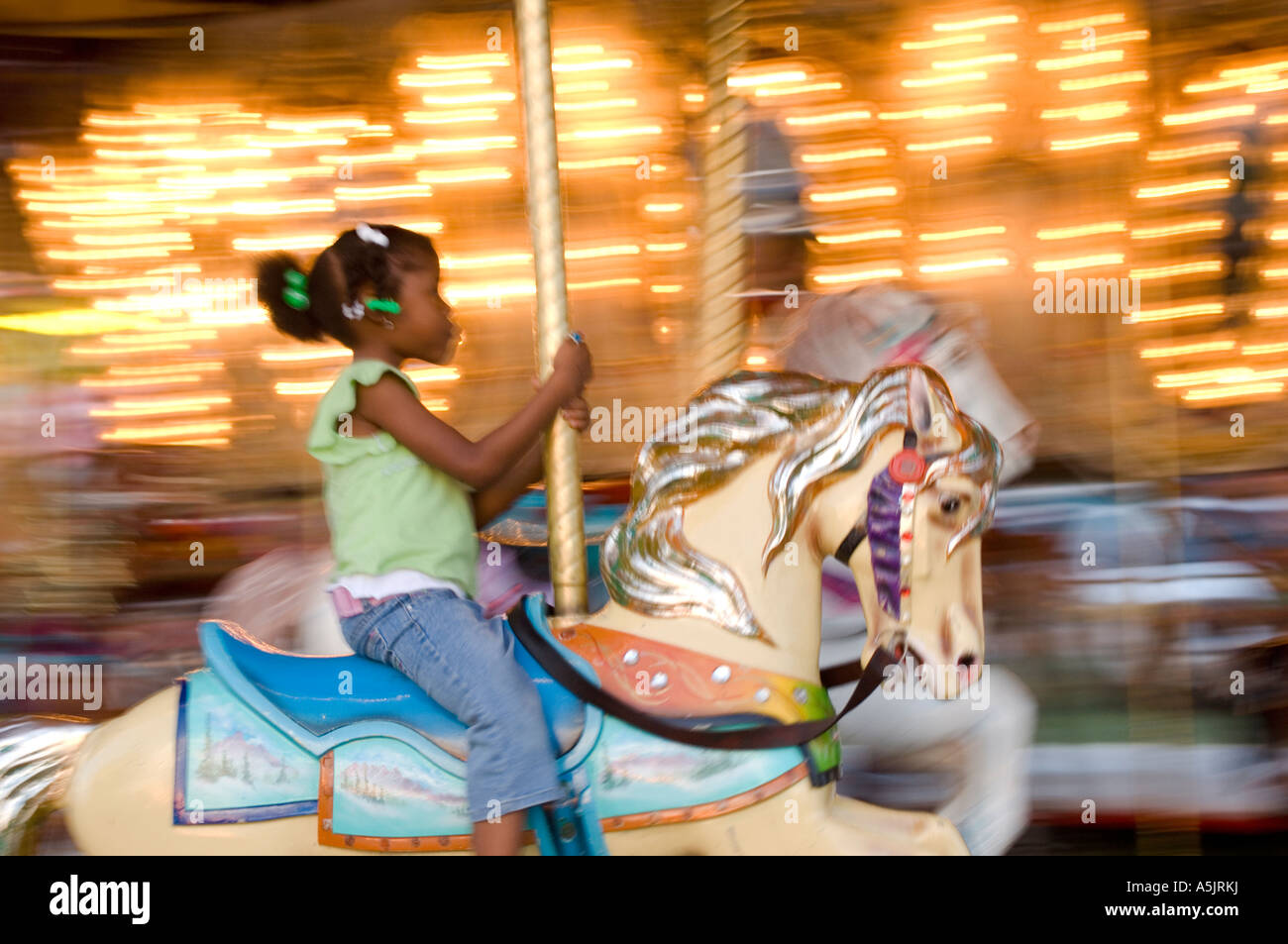 Girl on a ride at the Illinois State Fair in Springfield Illinois - Stock Image