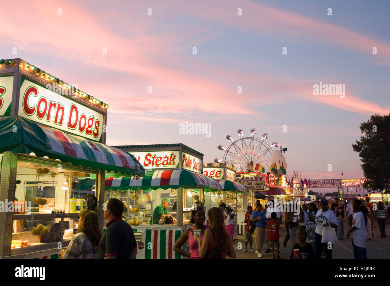 Food stands and ferris wheel at sunset at the Illinois State Fair in Springfield Illinois - Stock Image