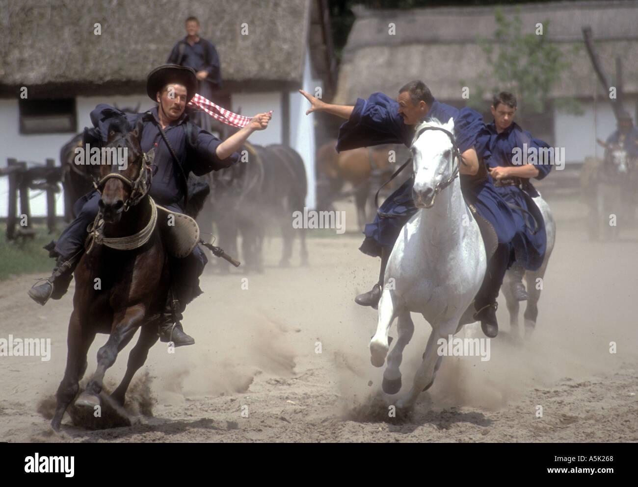 Magyar horseman play games at a show, Varga Tanya - Stock Image