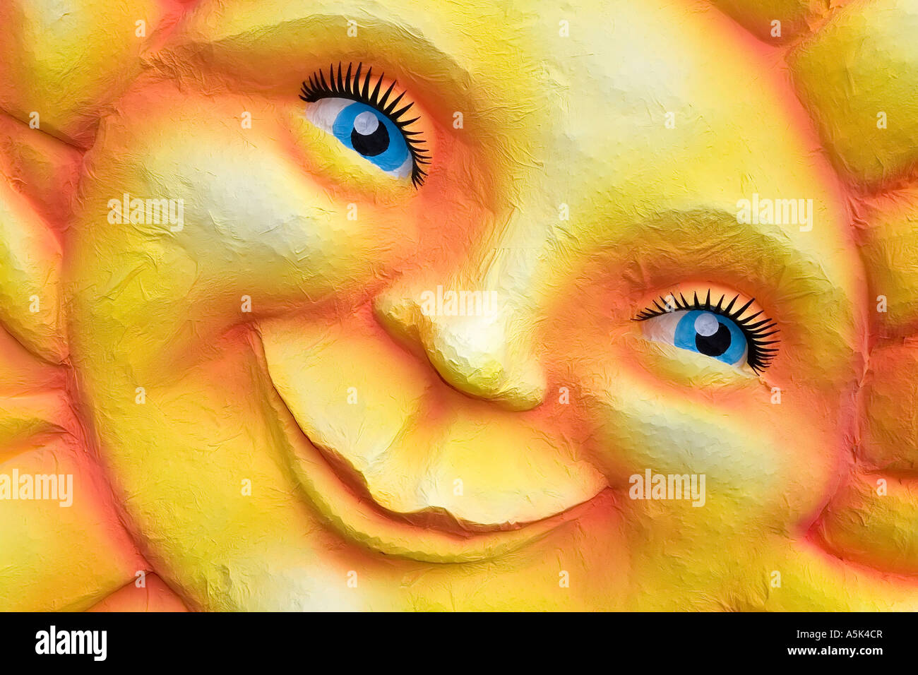 The sun laughs, face made of paper maché , monday before lent parade, Duesseldorf, NRW, Germany - Stock Image