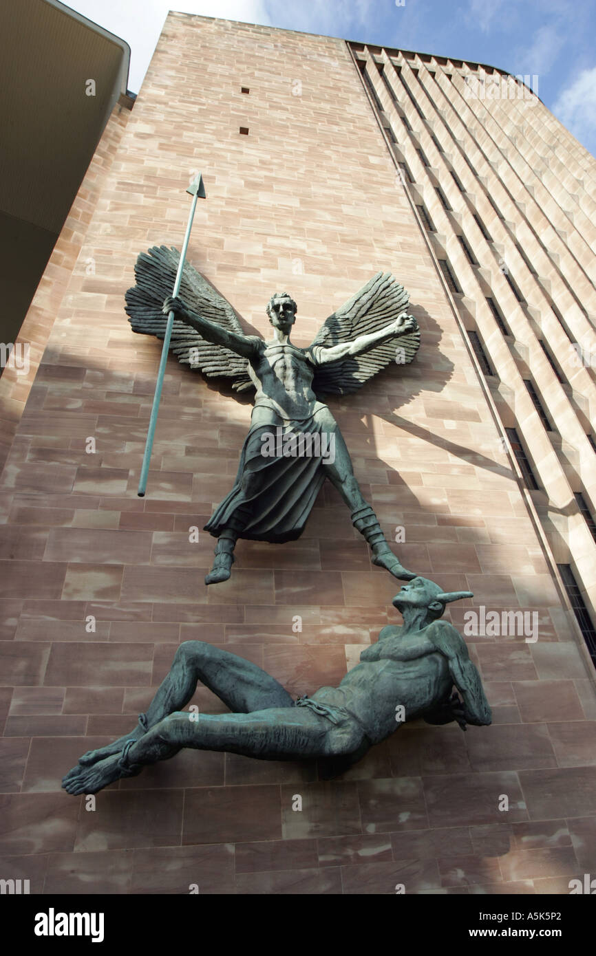 Bronze statue outside Coventry Cathedral designed by Sir Jacob Epstein, depicts Saint Michael overcoming the Devil. - Stock Image