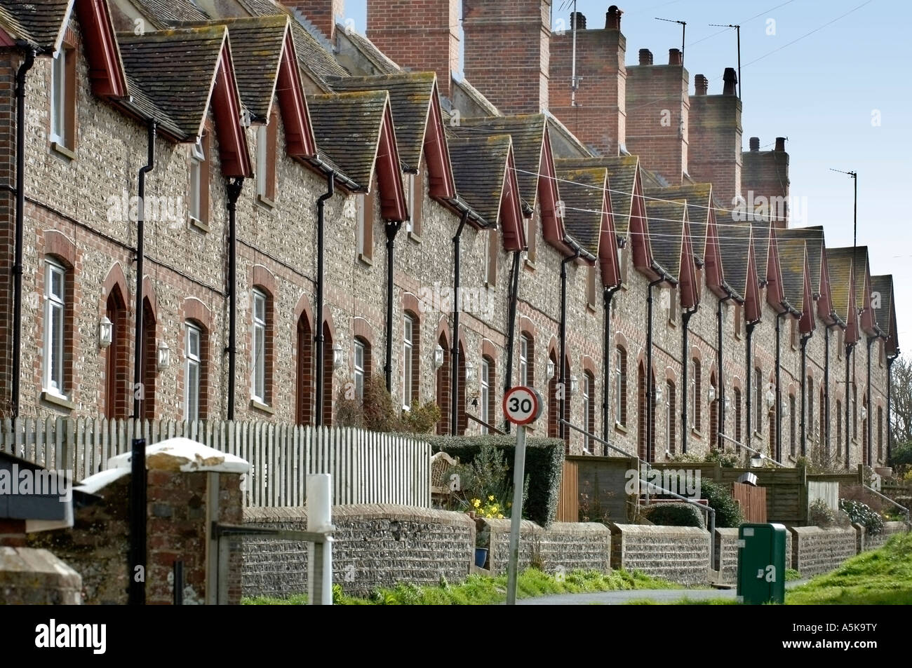 A row of flint fronted terraced houses in Glynde East Sussex - Stock Image