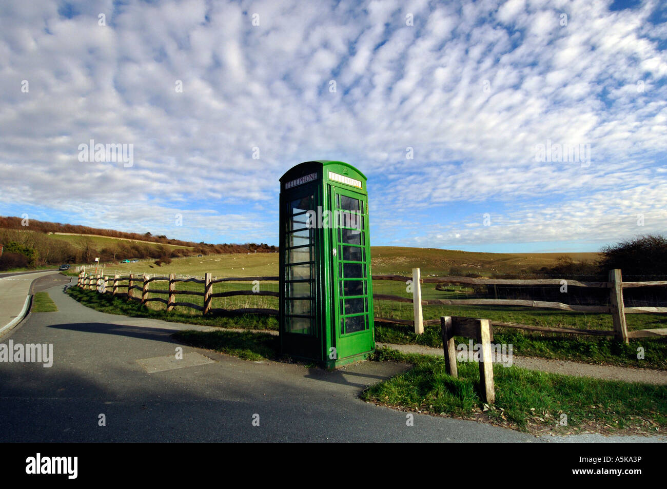 A British Telecom green K6 telephone box on a quiet county lane in Sussex - Stock Image
