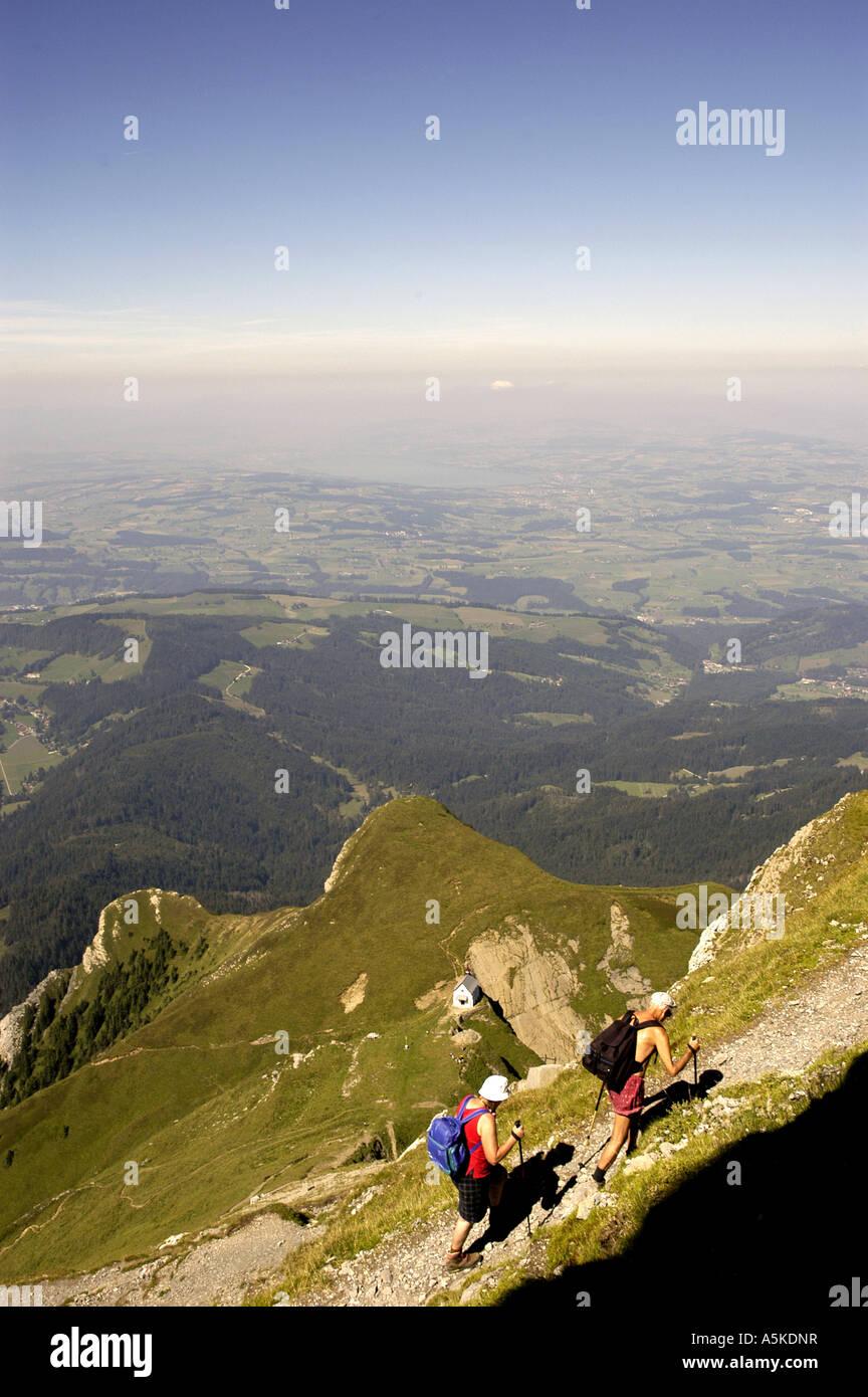 Lucerne luzern Switzerland older couple hiking up Mount Pilatus - Stock Image