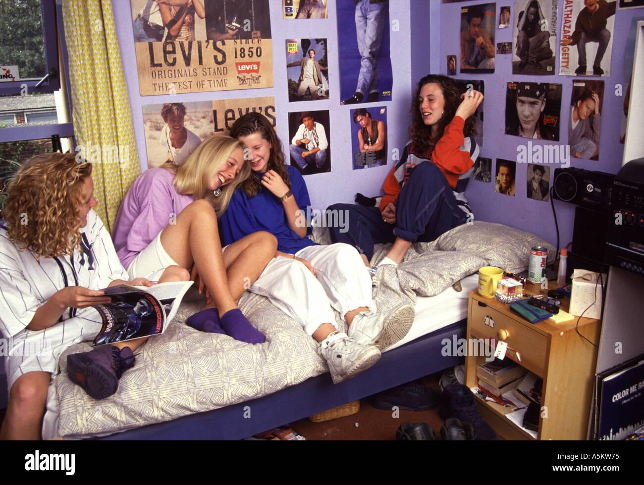 Group Of Teenage Girls Sitting In Bedroom Stock Photo Alamy
