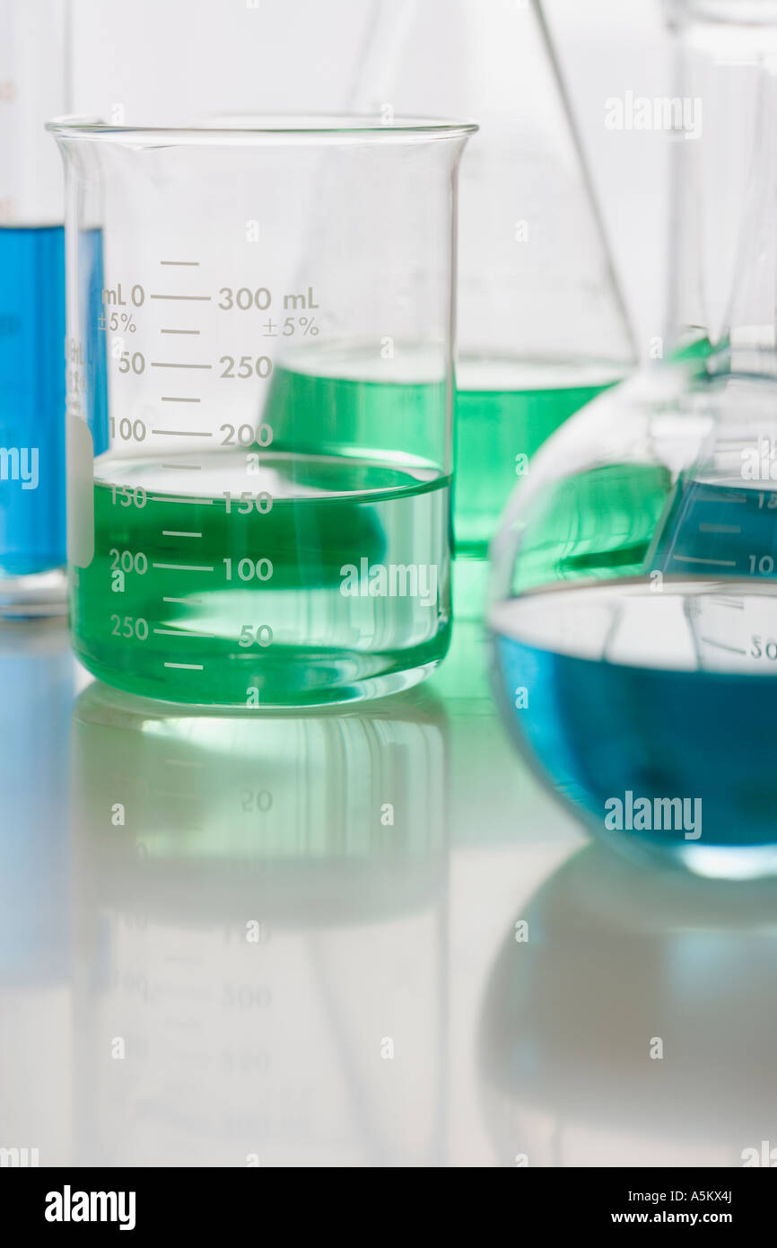 Close up of beakers with liquid - Stock Image