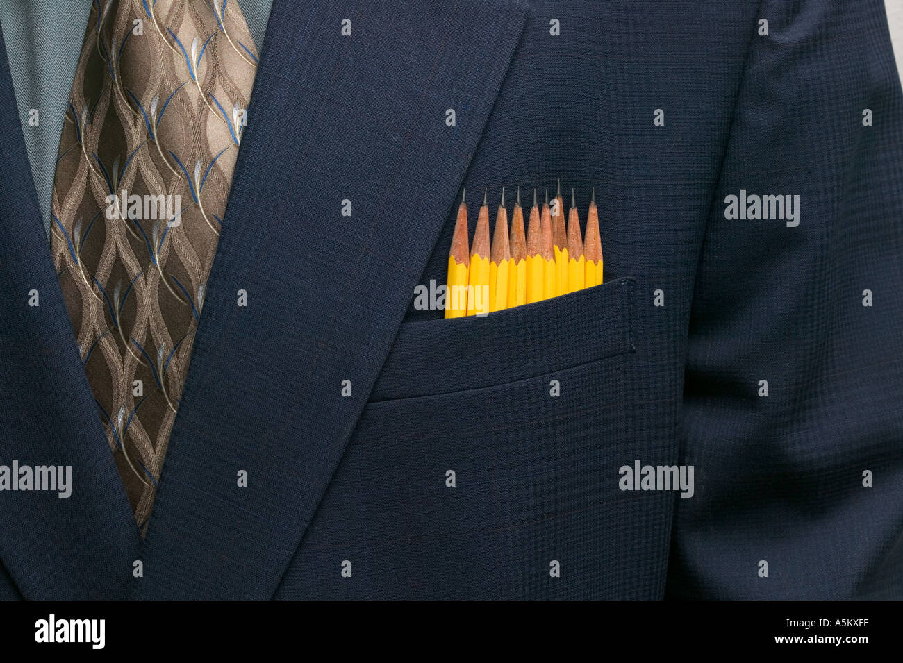 row of pencils in suit pocket of executive - Stock Image