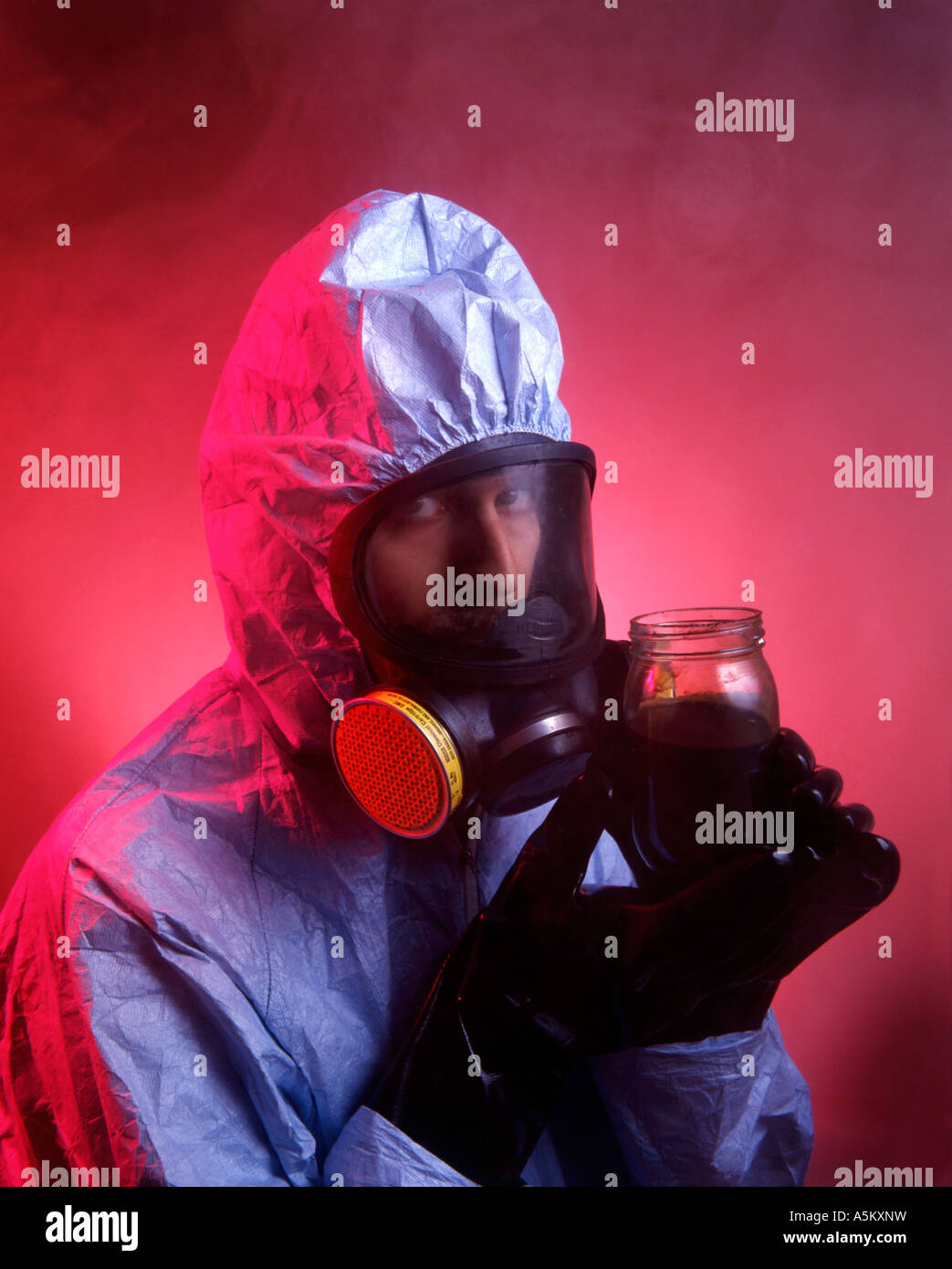 Toxic material handler in chemical cleanup suit - Stock Image