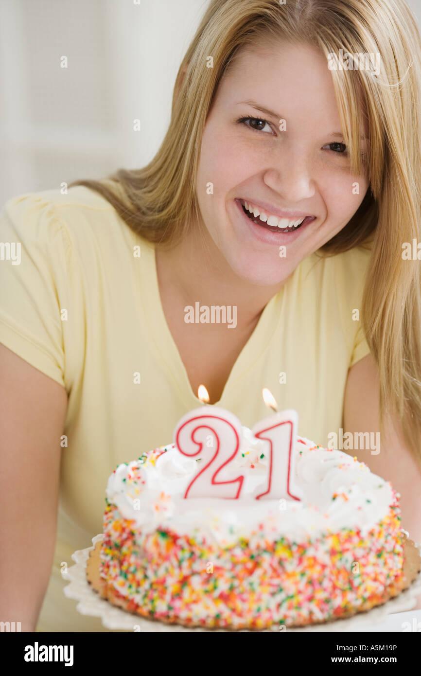 Portrait of woman with Twenty First birthday cake Stock Photo