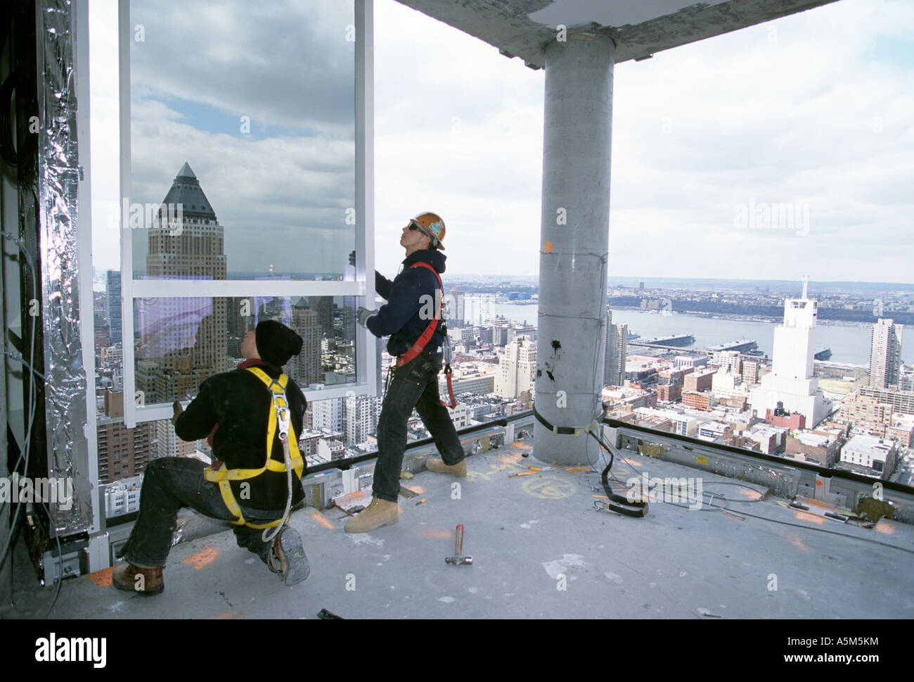Workers, With Safety Harness Unclipped, Installing Curtain Wall At Random  House Building In New York City