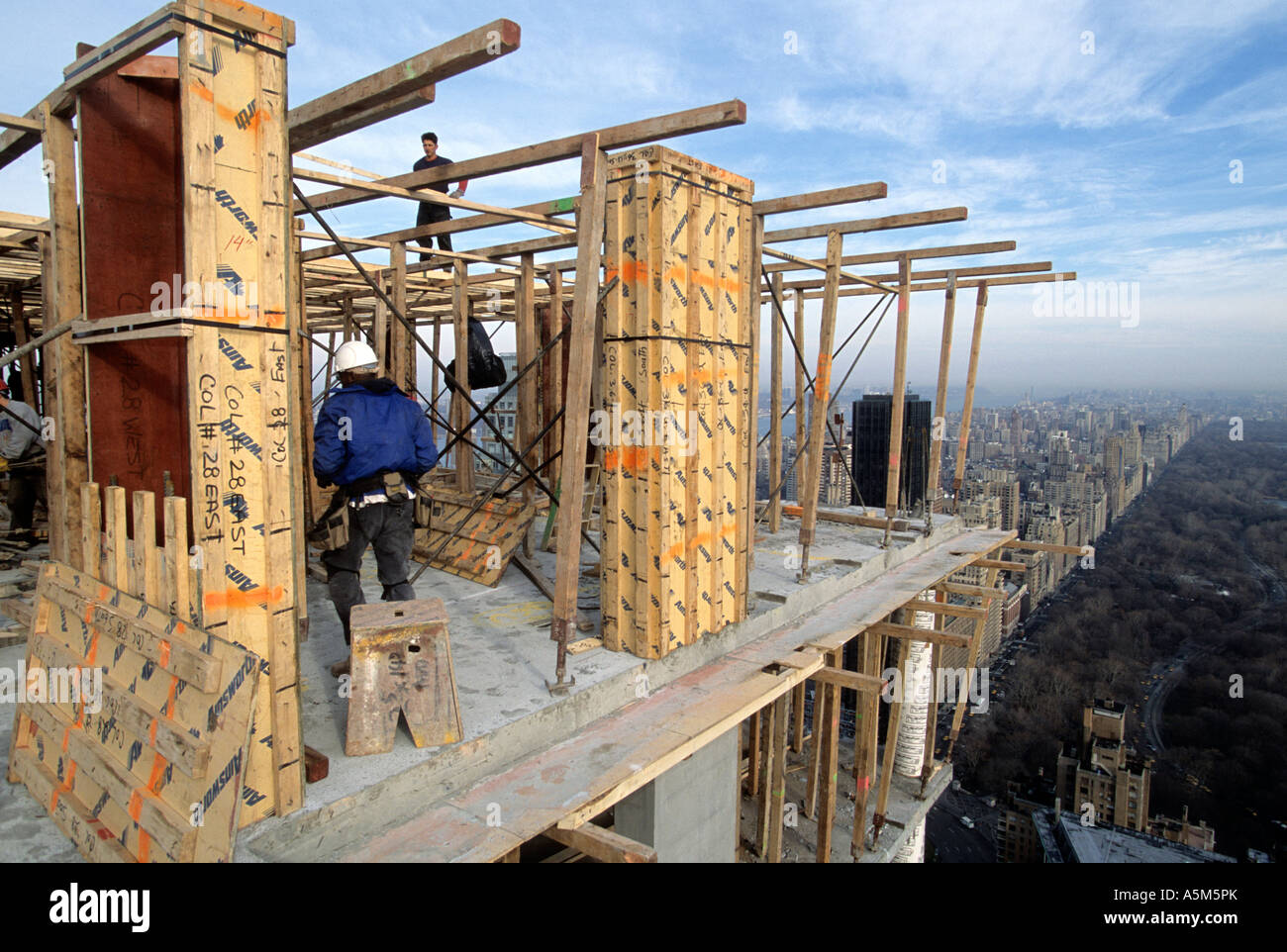 Carpenters build frame for floors in reinforced concrete construction in New York City - Stock Image