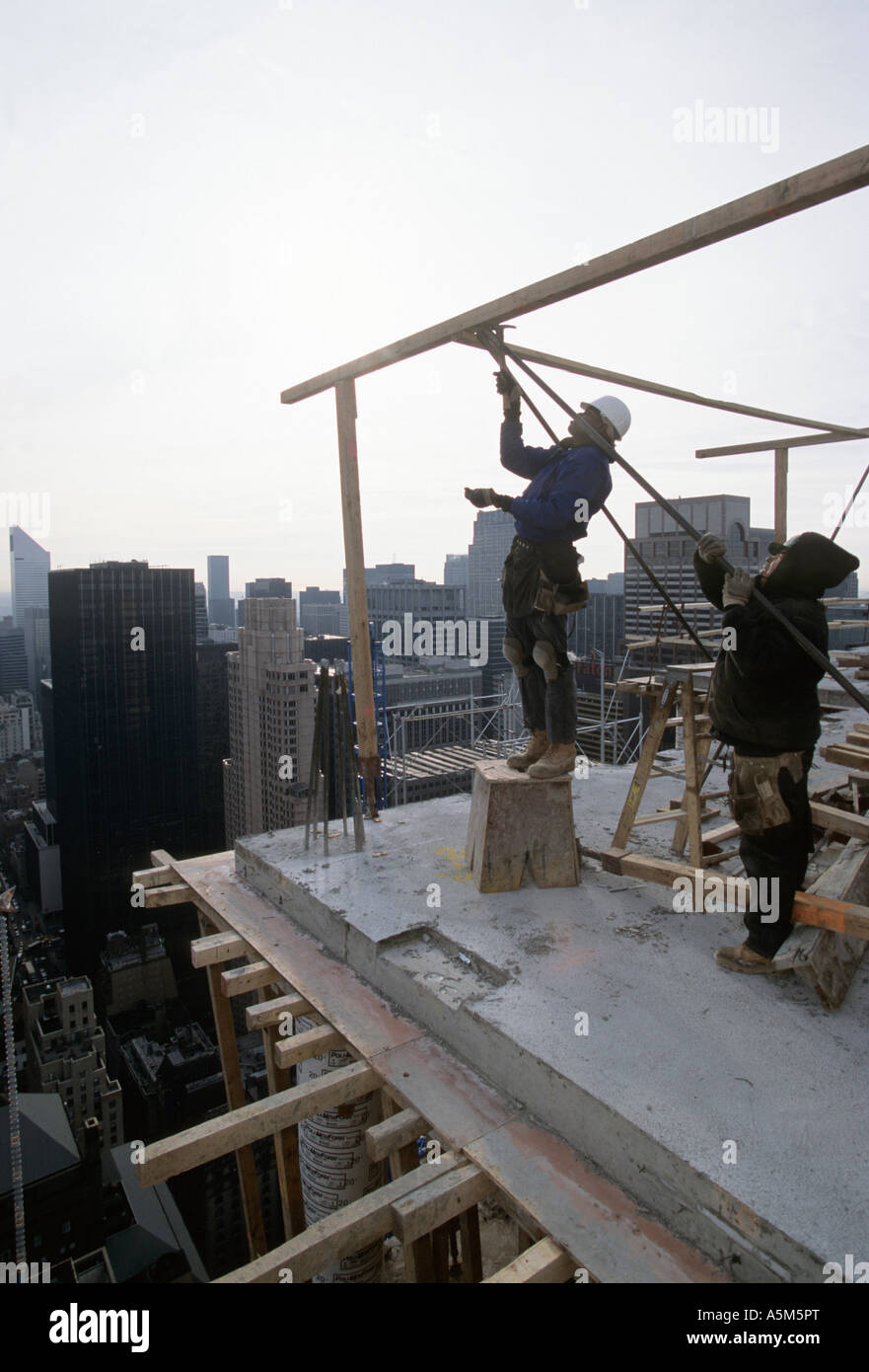 Carpenters build framing for reinforced concrete construction in New York City.