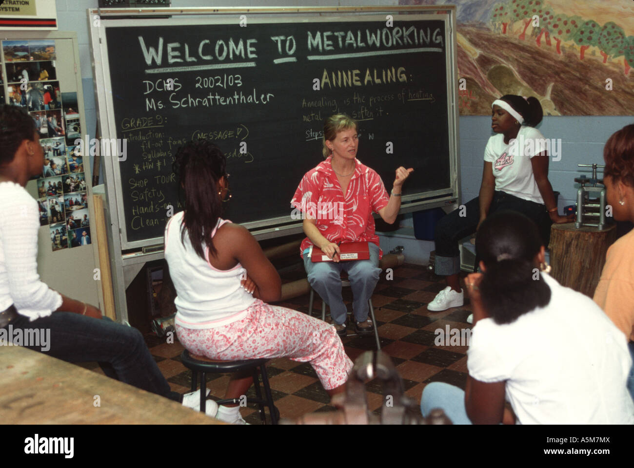 Female teacher teaches metalwork class at an inner city high school in Detroit, MI.  USA - Stock Image