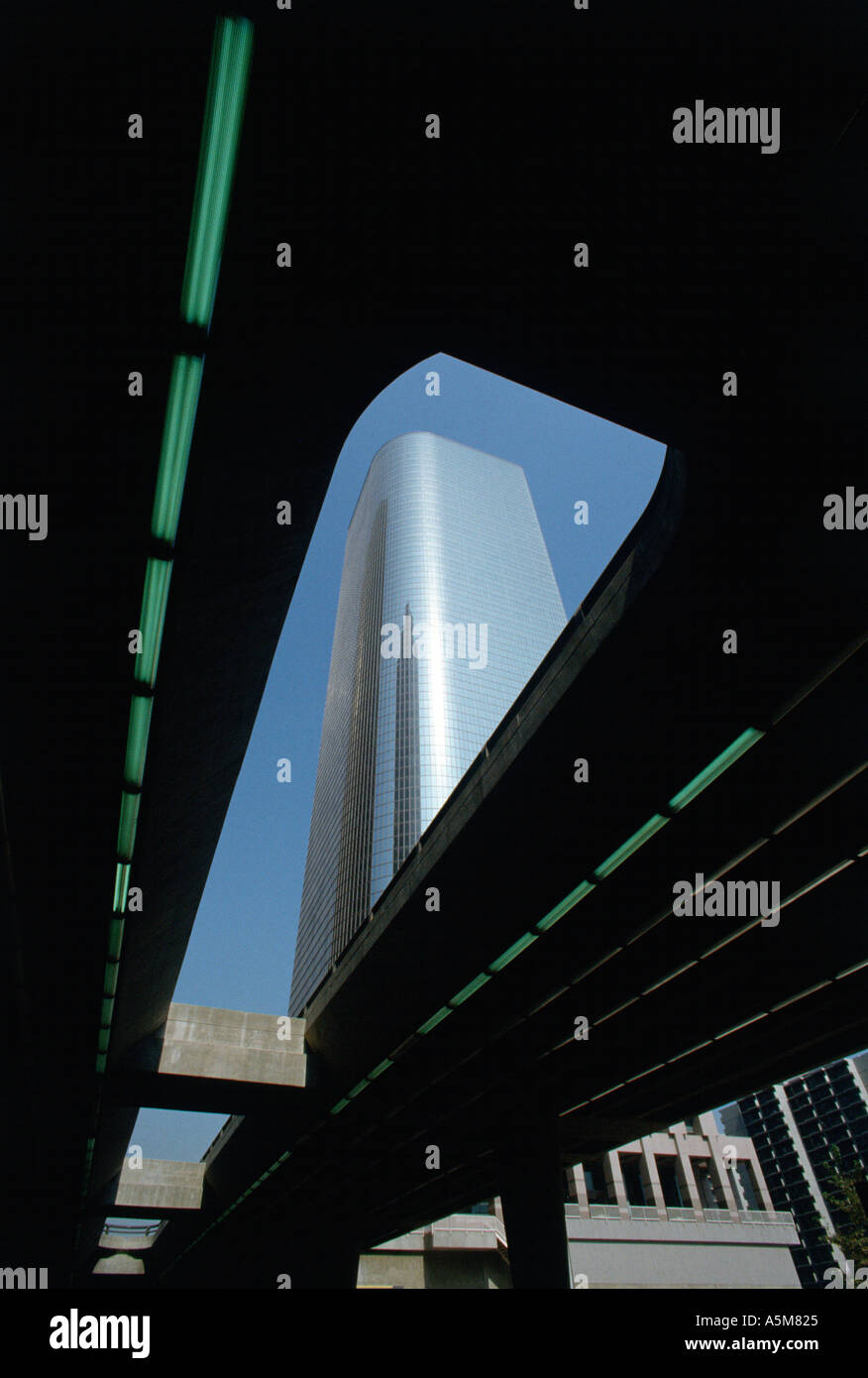 Hi rise office building as viewed from below an elevated street in downtown Los Angeles California - Stock Image