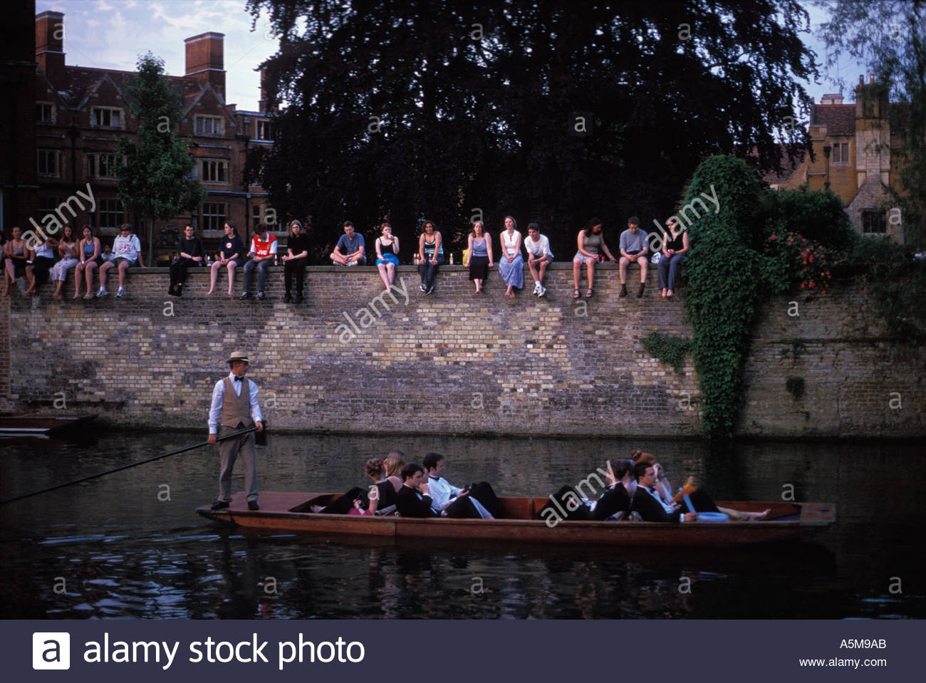 Guests arrive on punts for the Clare College May Ball overlooked by perhaps less affluent college undergraduates, Cambridge, UK - Stock Image
