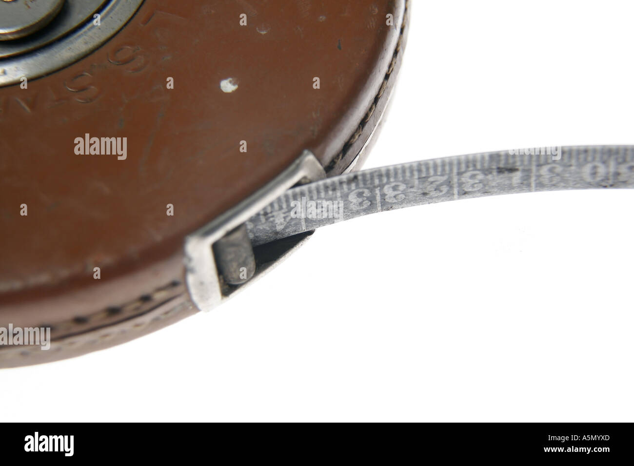 Studio shot of old leather bound tape measure, using a shallow depth of field and focused on the number 32 - Stock Image
