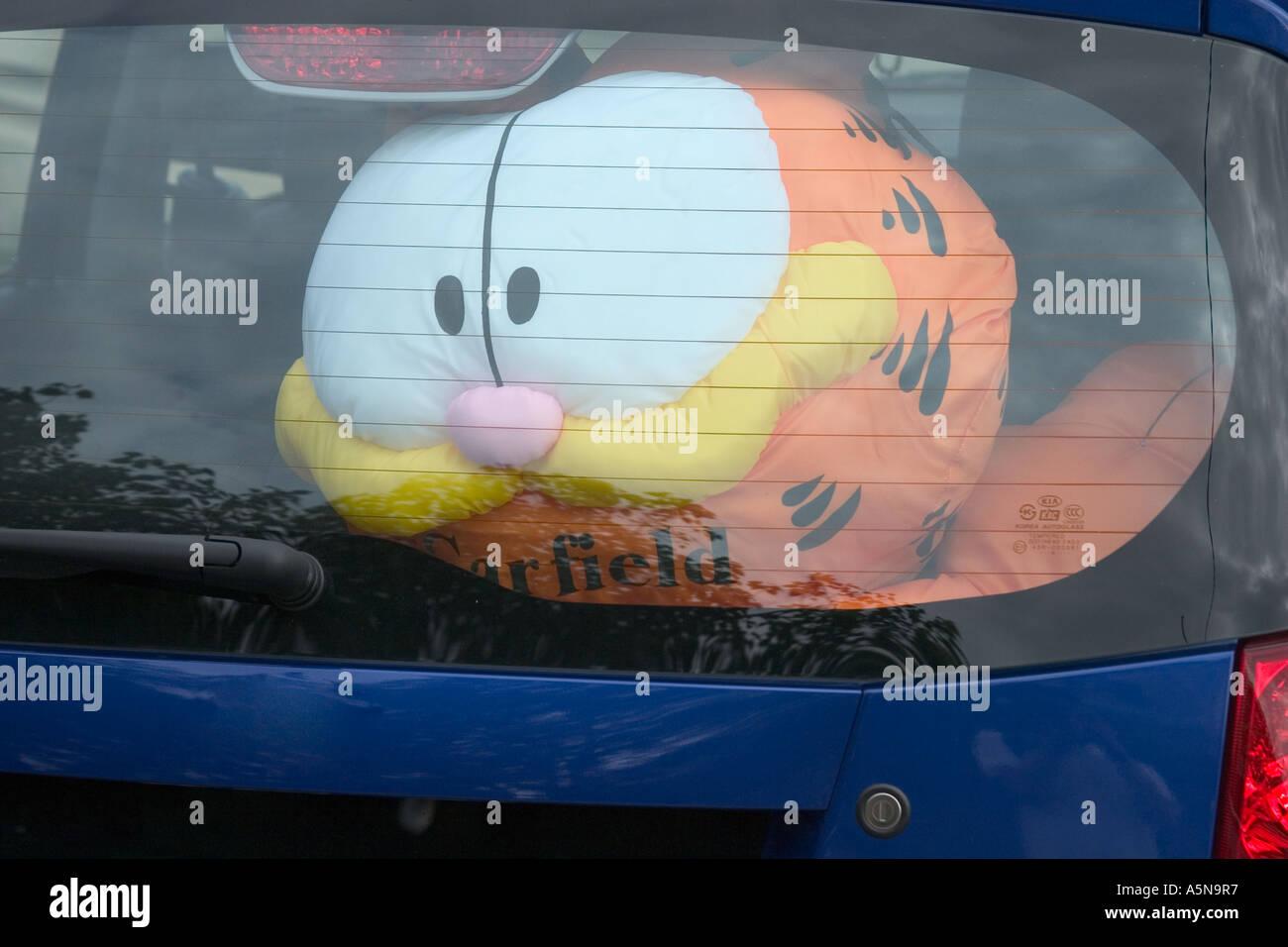 Garfield Doll Behind Car Window Stock Photo Alamy