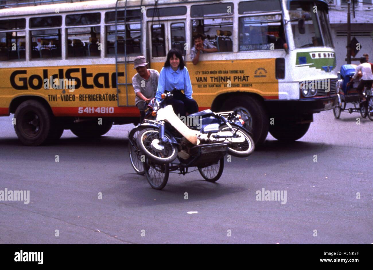 A CYCLO TRANSPORTS A MOTORCYCLE SAIGON VIETNAM - Stock Image