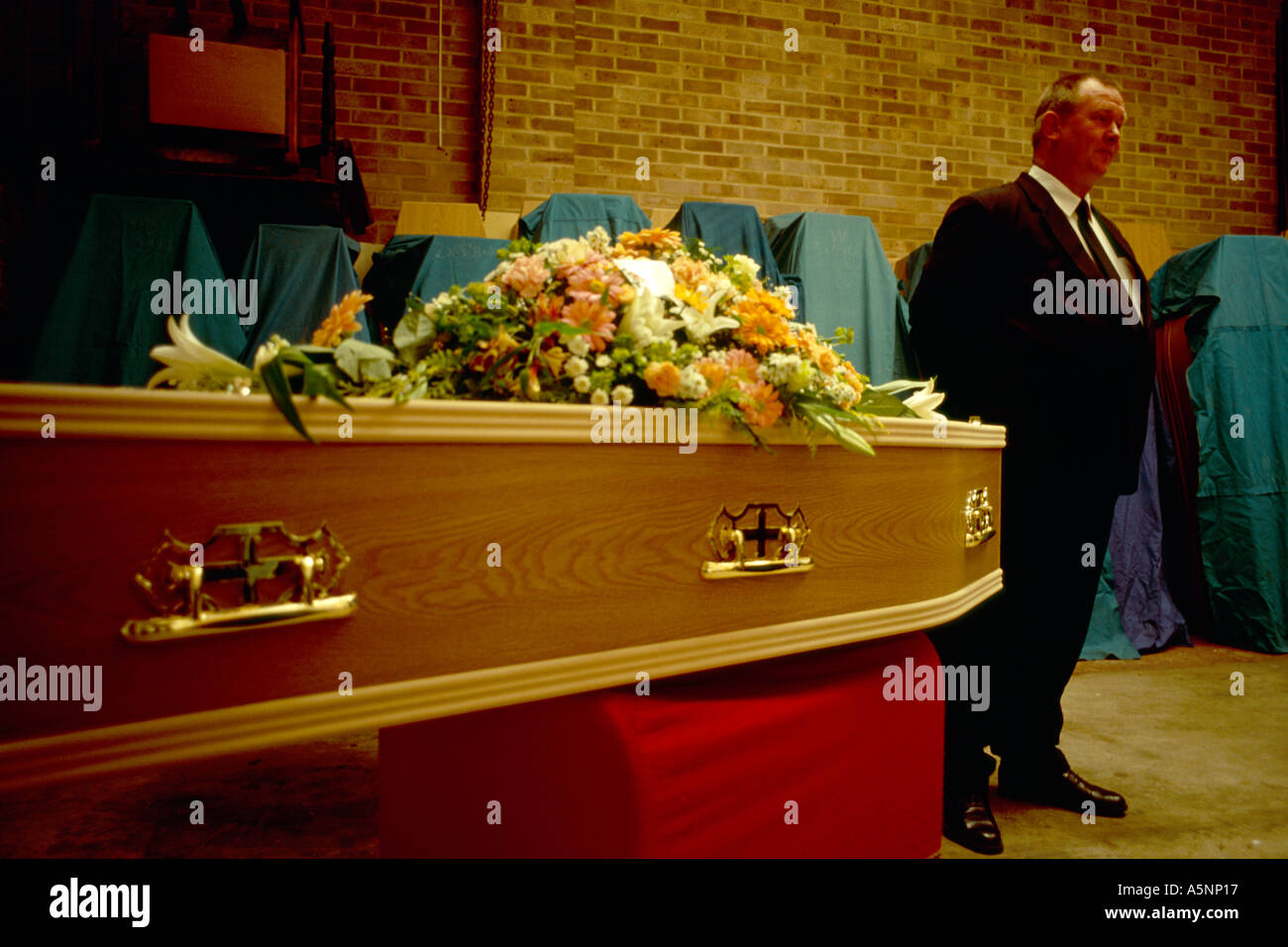 A coffin awaits funeral. - Stock Image