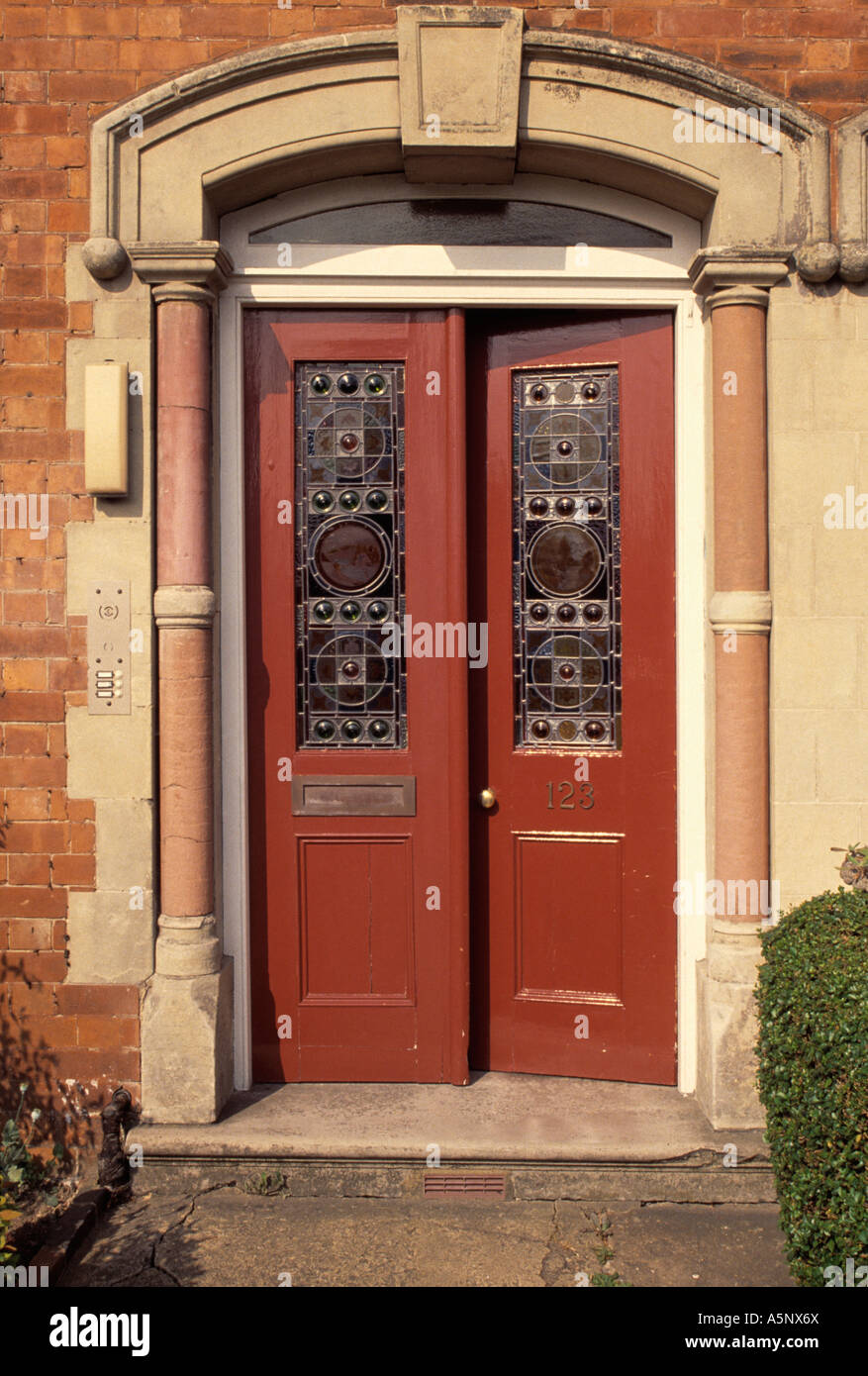 Brown double Edwardian front door with stained glass panels Stock ...