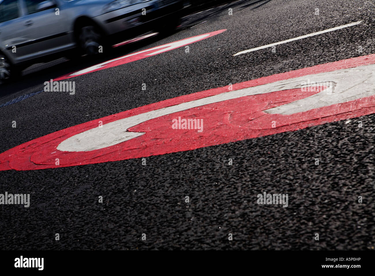 Congestion charge road marking as card drives over it at Elephant Castle London - Stock Image