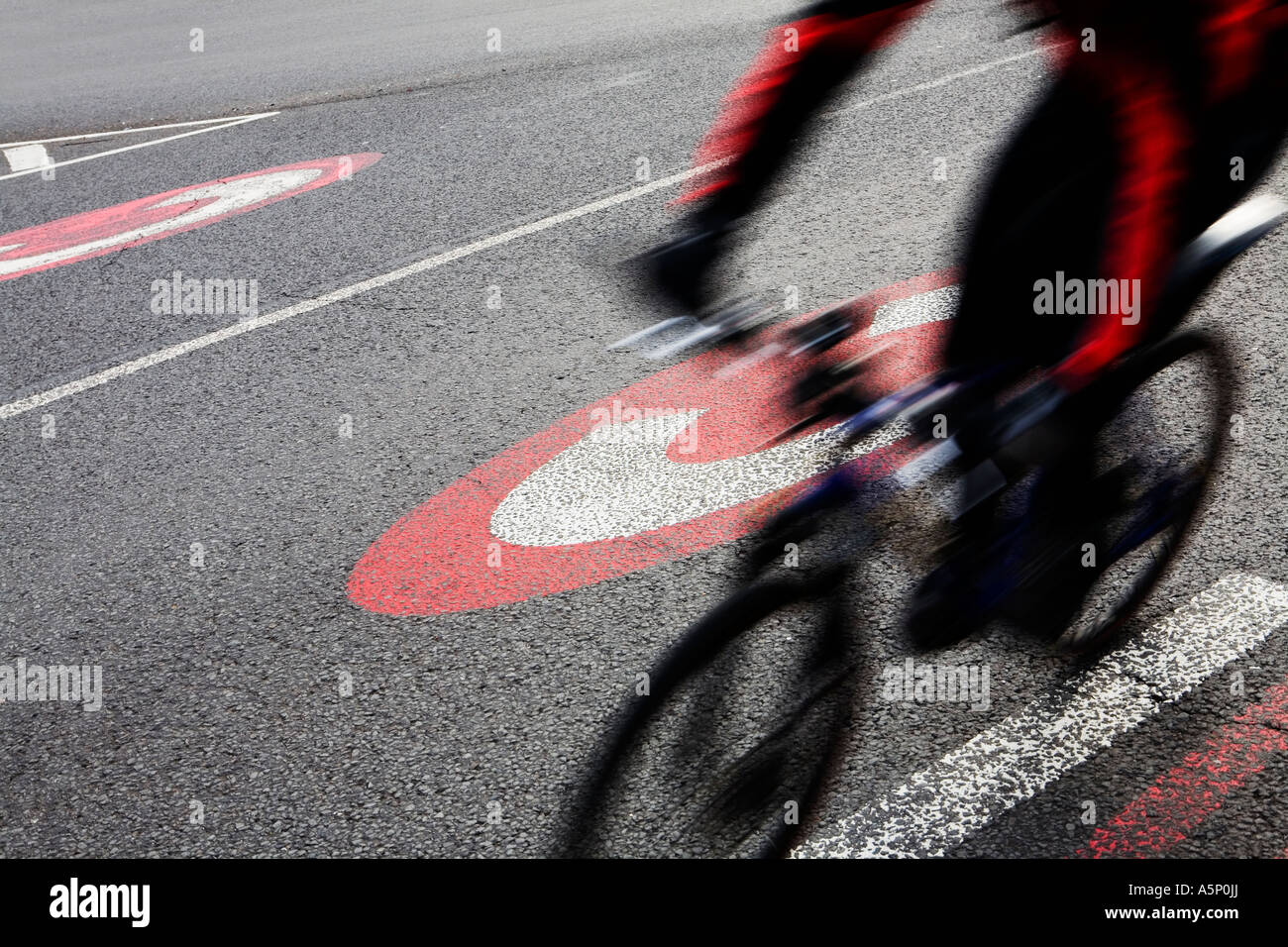 Congestion charge road marking as cyclist rides past it at Elephant Castle London Bicycles are exempt from congestion - Stock Image