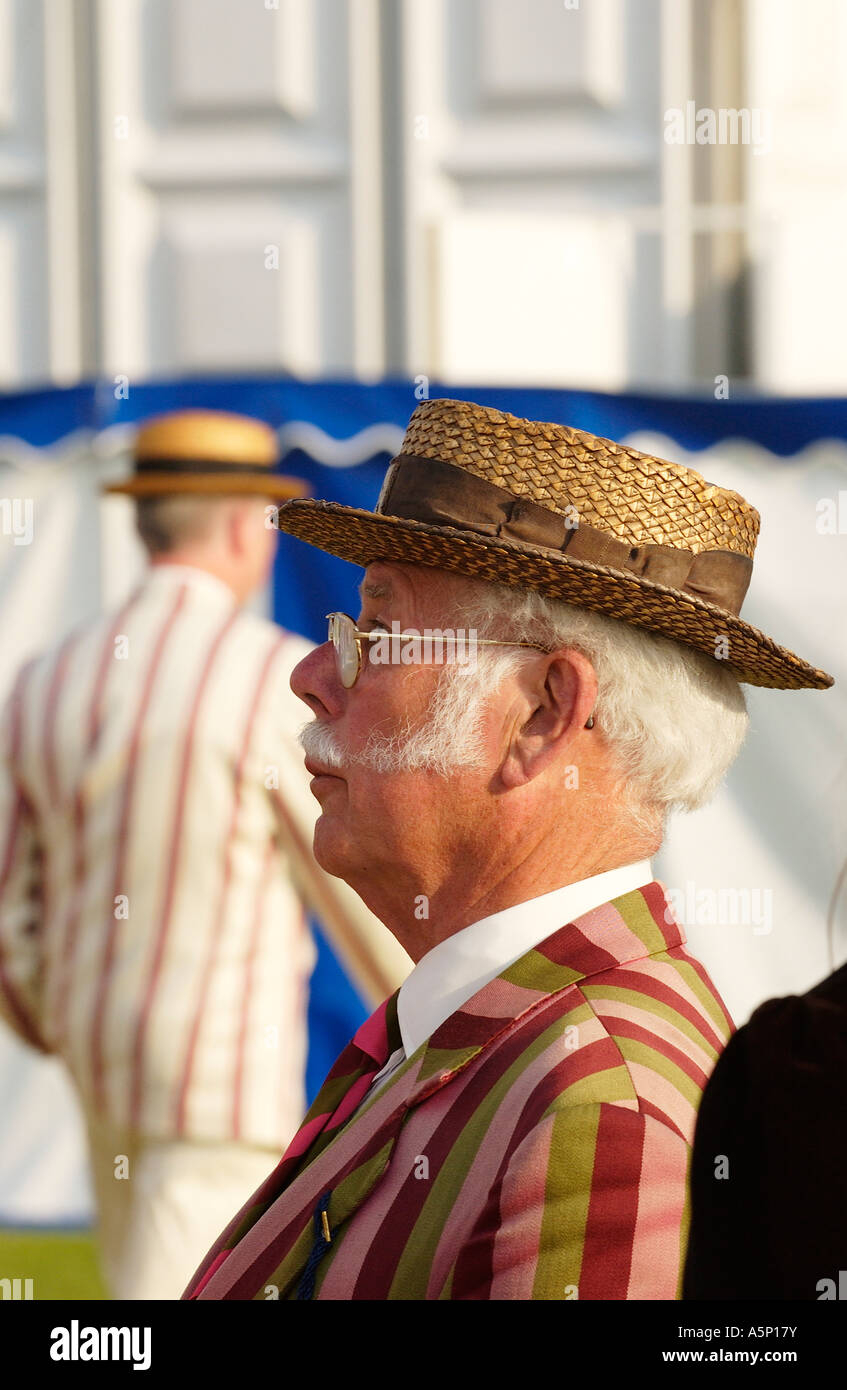 Spectators preserving the Edwardian traditions of dress at the Henley Royal Regatta, Henley-on-Thames, Oxon, Uk - Stock Image